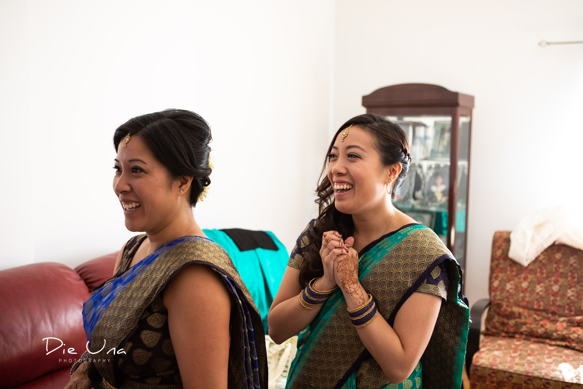 bridesmaids wearing sarees reacting to seeing the bride.jpg