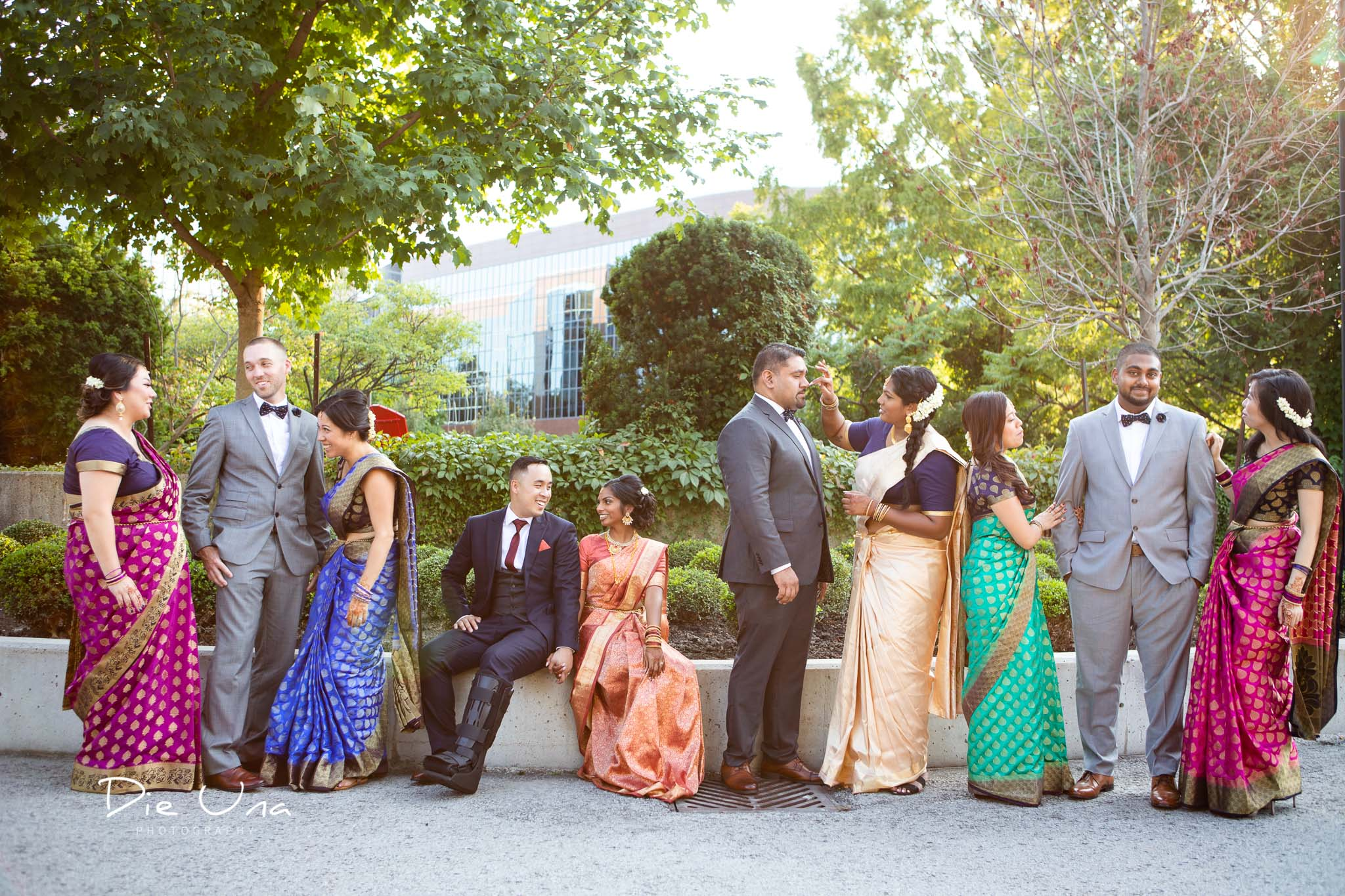 casual portrait of wedding party wearing colorful sarees in Toronto.jpg