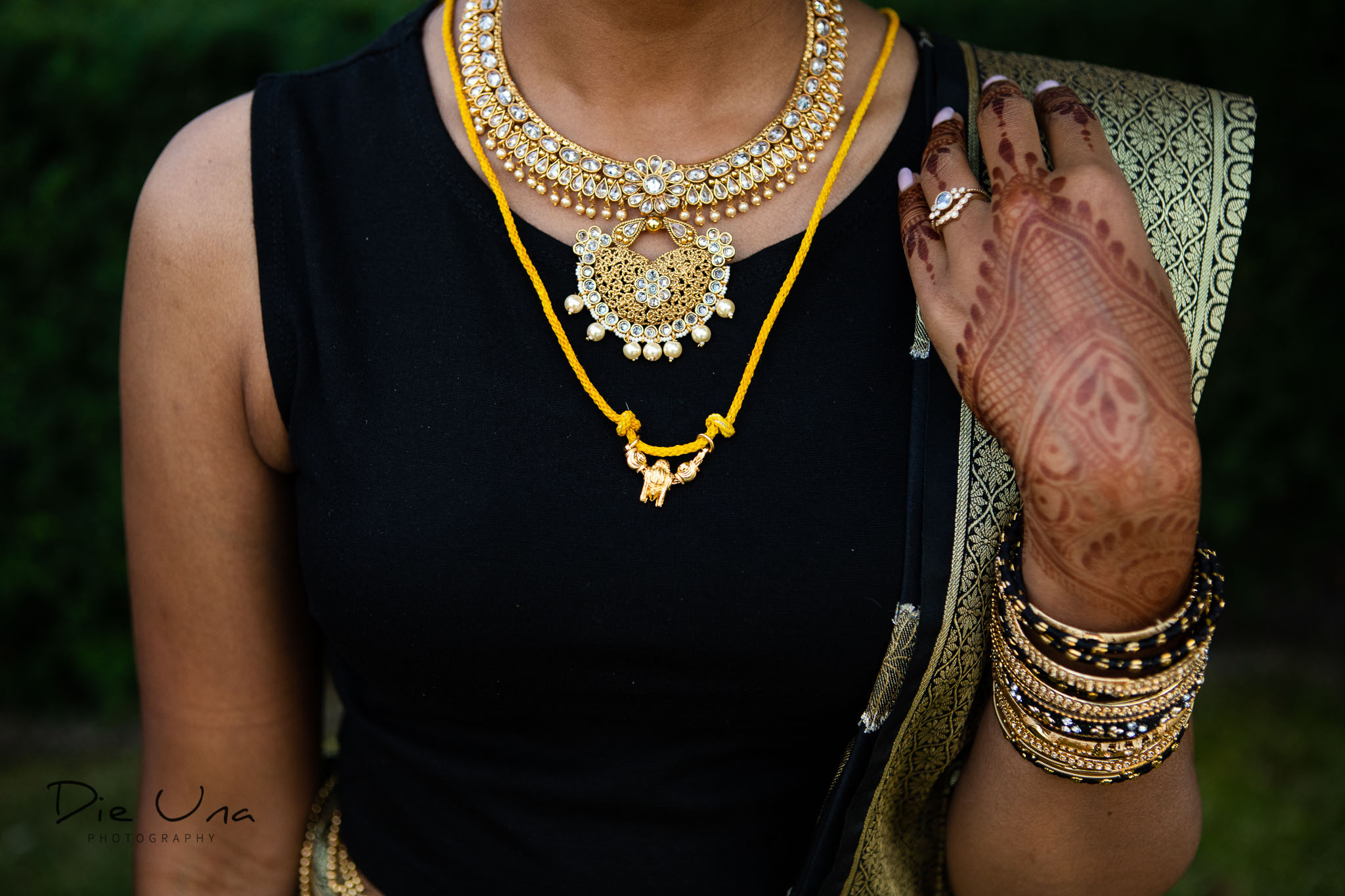 close up of bride wearing evening outfit and thaali.jpg