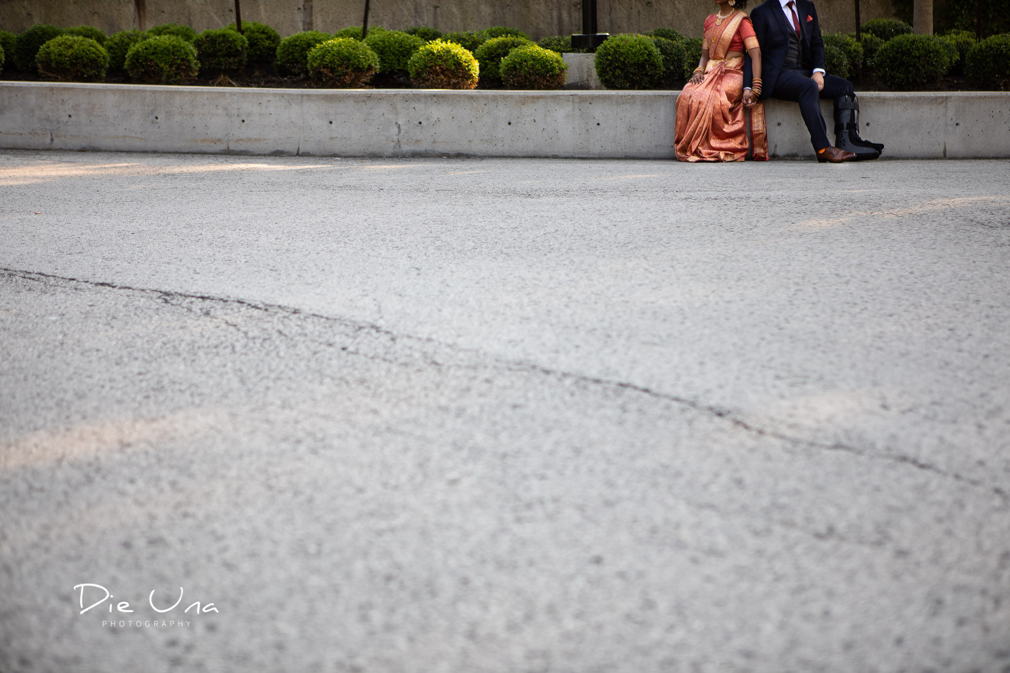 creative view of bride and groom holding hands.jpg