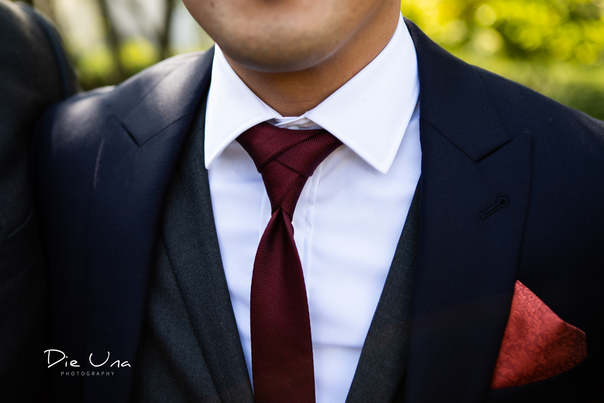 detail shot of groom with an eldredge tie knot.jpg