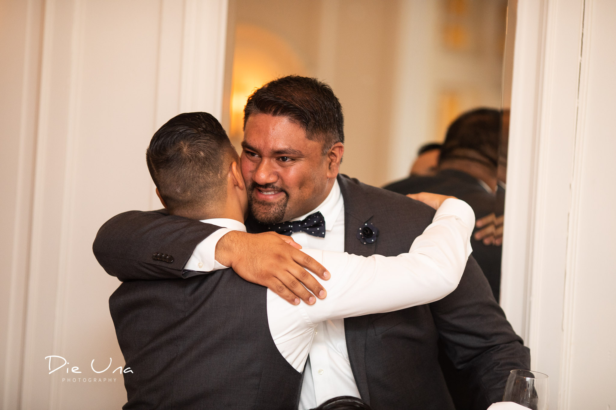groom and bestman hugging after speech.jpg