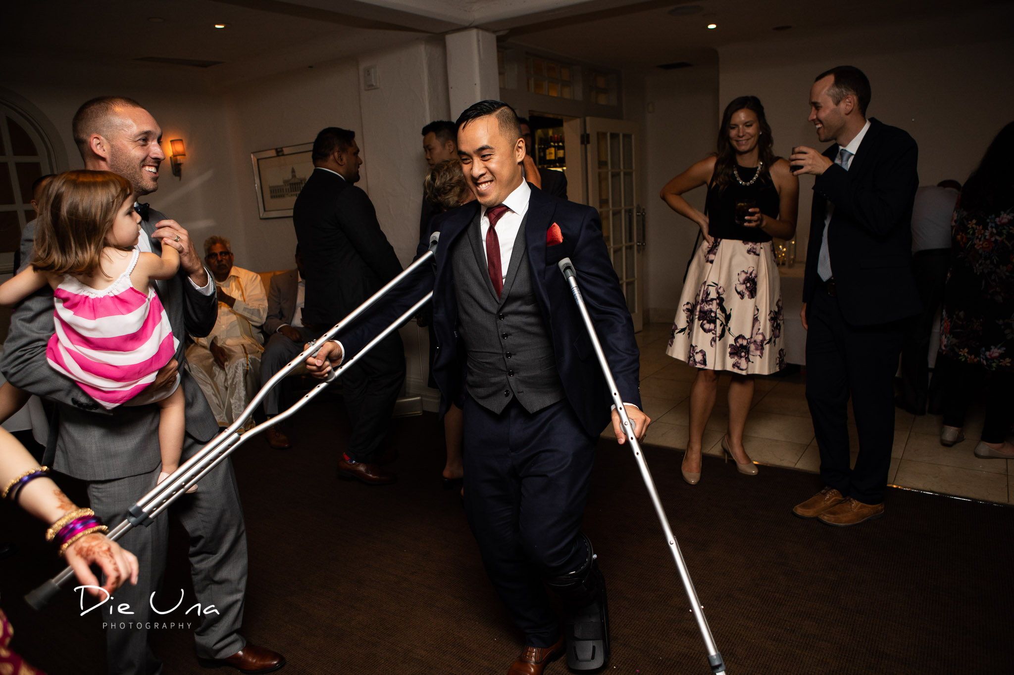 groom crutch dancing during reception.jpg