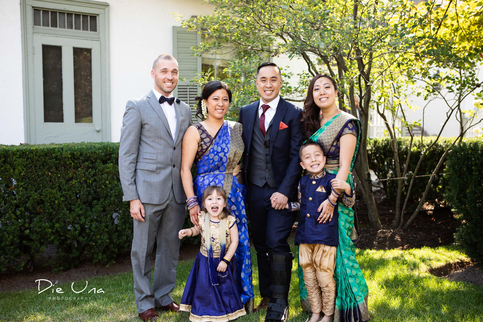 groom family portrait with sisters and neice and newphew.jpg