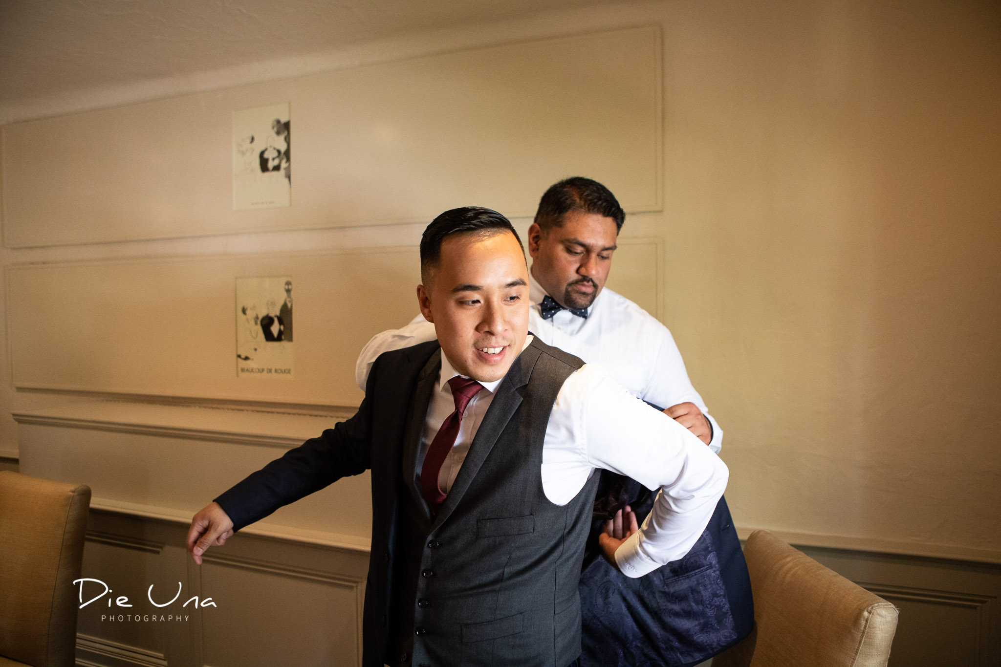 groom getting ready in the Auberge du Pommier in Toronto.jpg