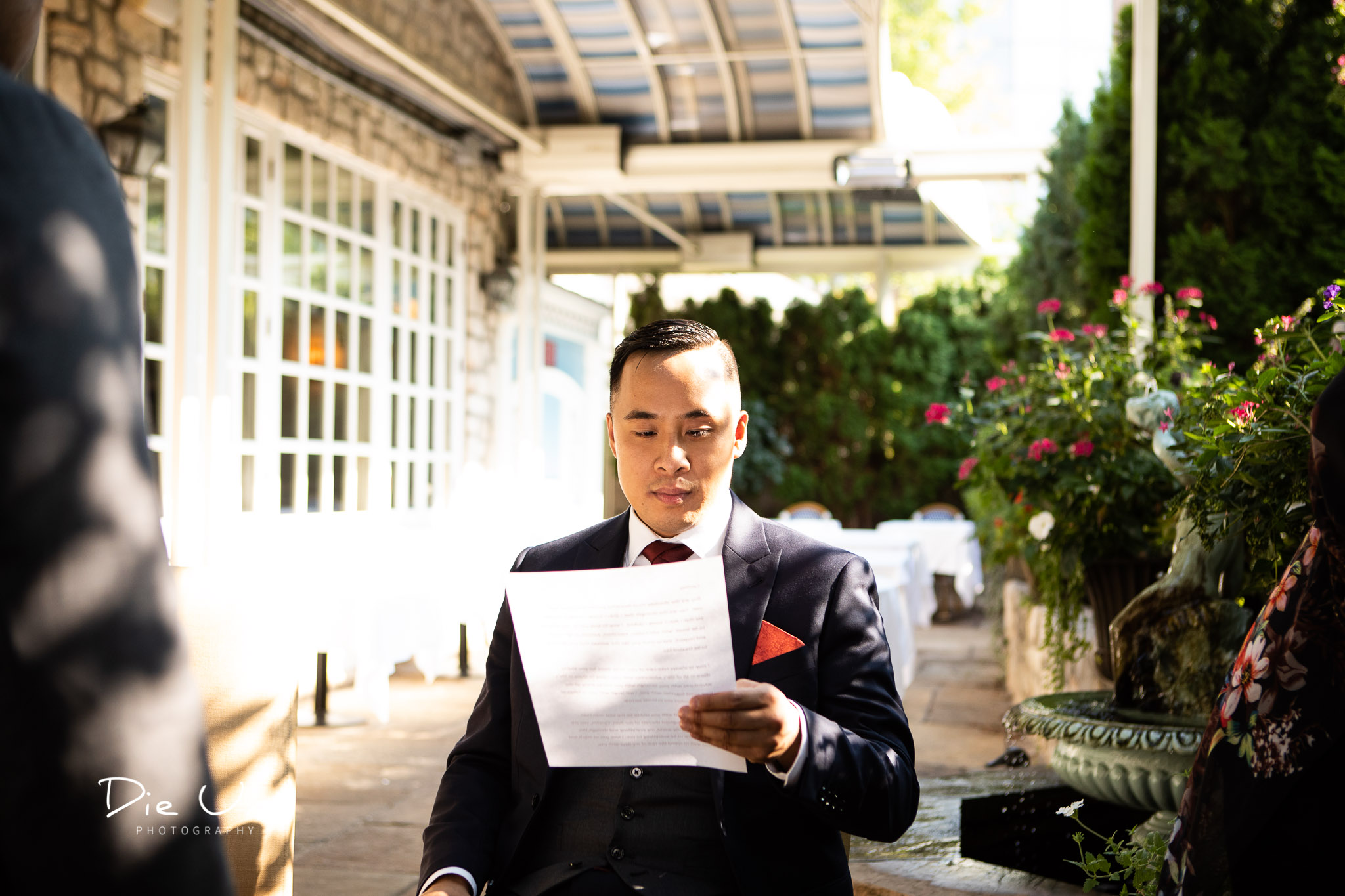 groom reading over his vows just before the ceremony.jpg