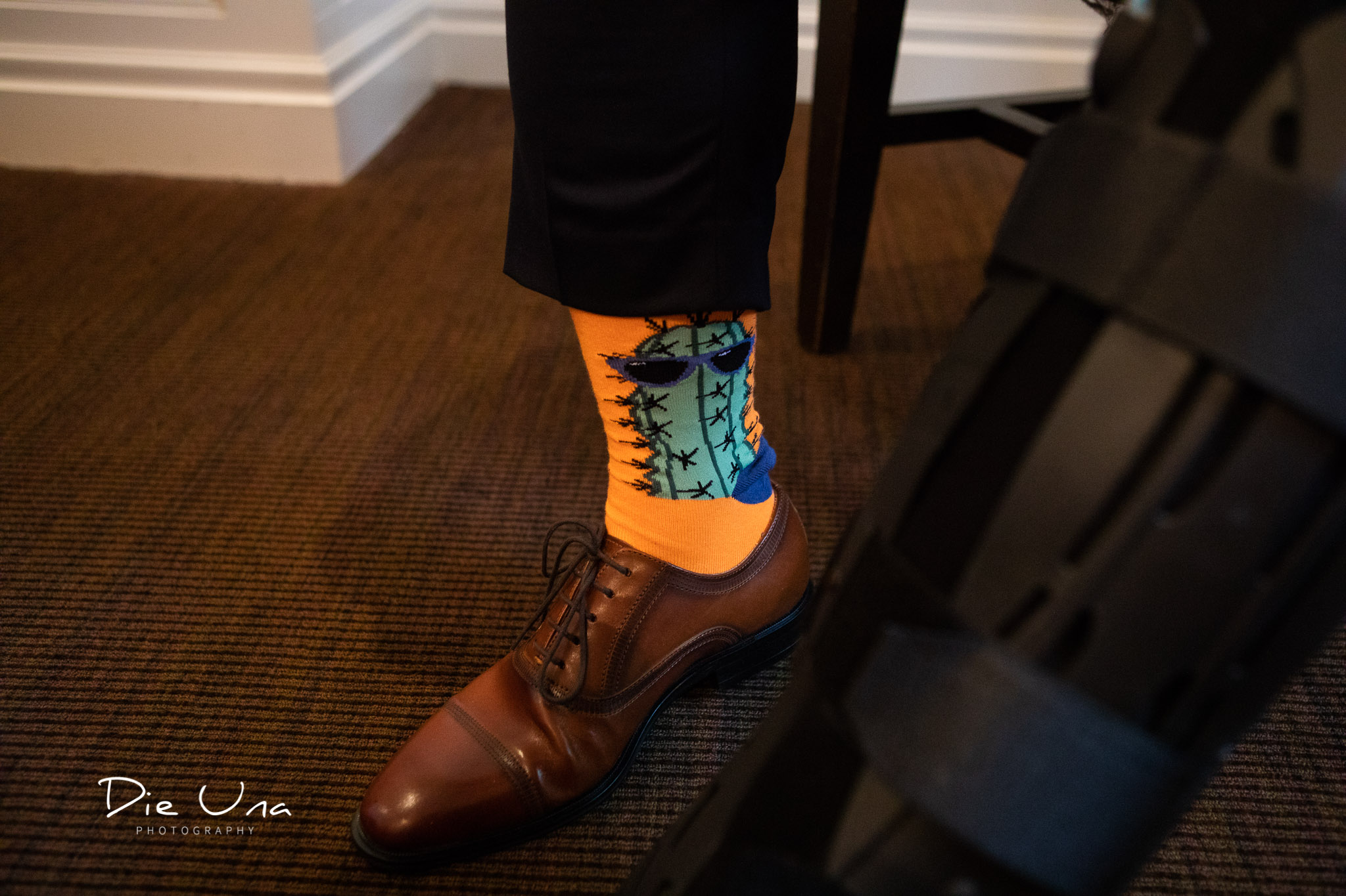 groom's fancy orange socks with a cactus on the sock.jpg