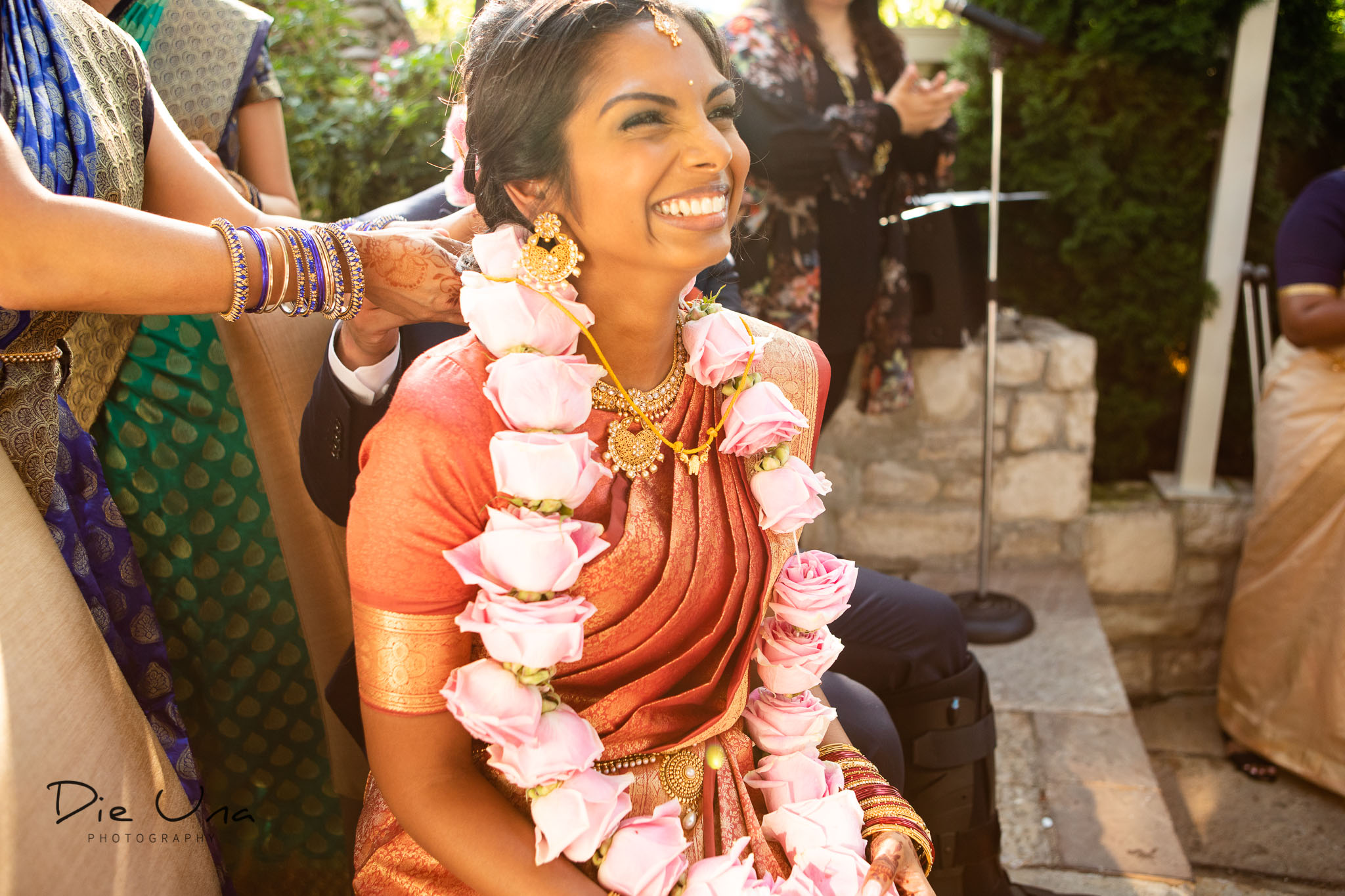 happy bride during the tying of the thaali during Sri Lankan wedding ceremony.jpg