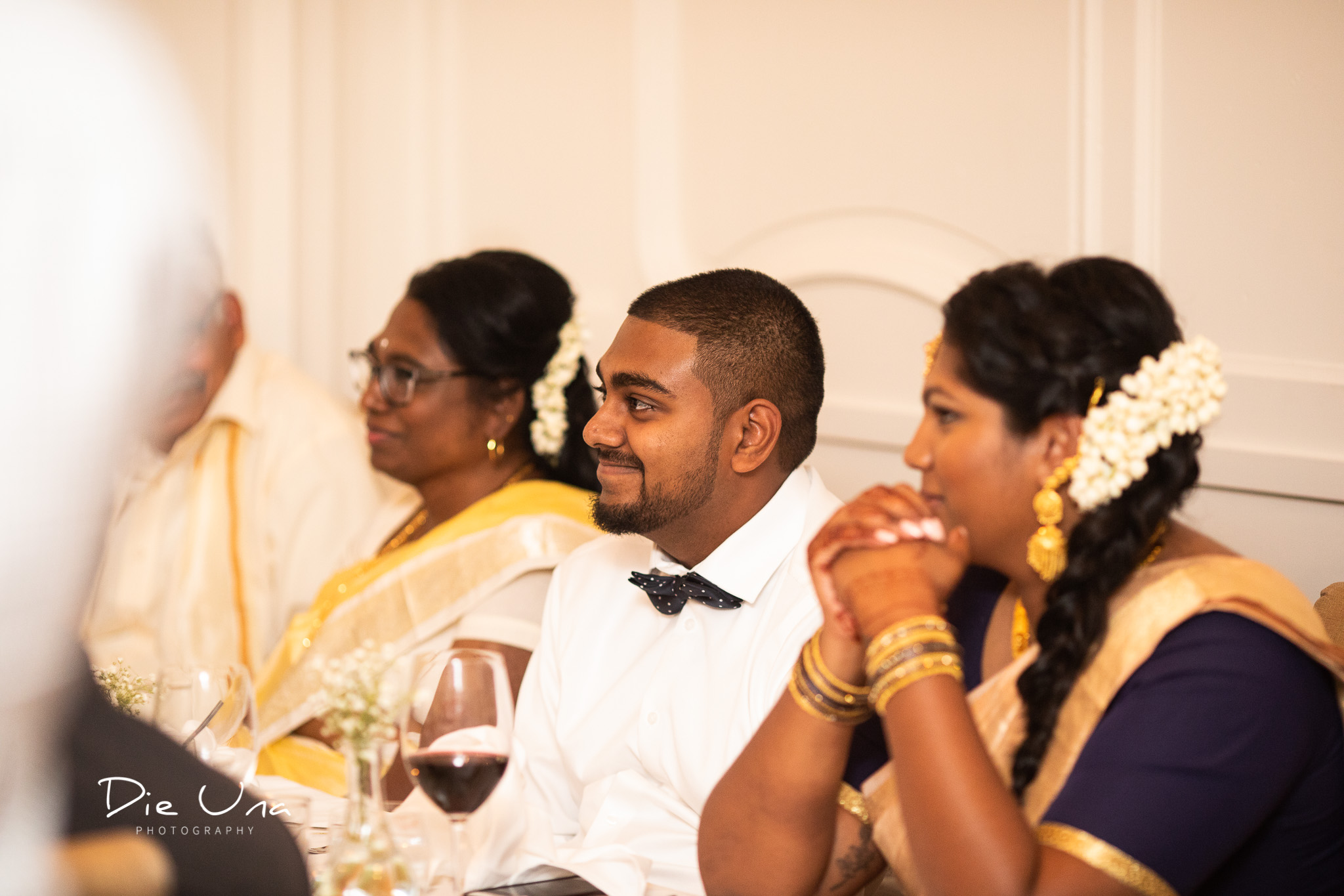happy guests during speeches at wedding.jpg