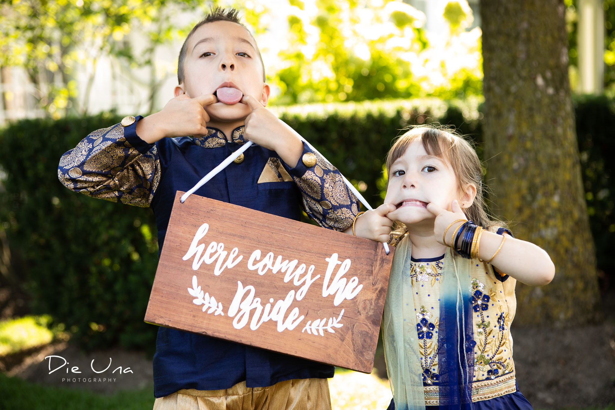 kids giving their best silly face during wedding portraits with Dieuna photography.jpg
