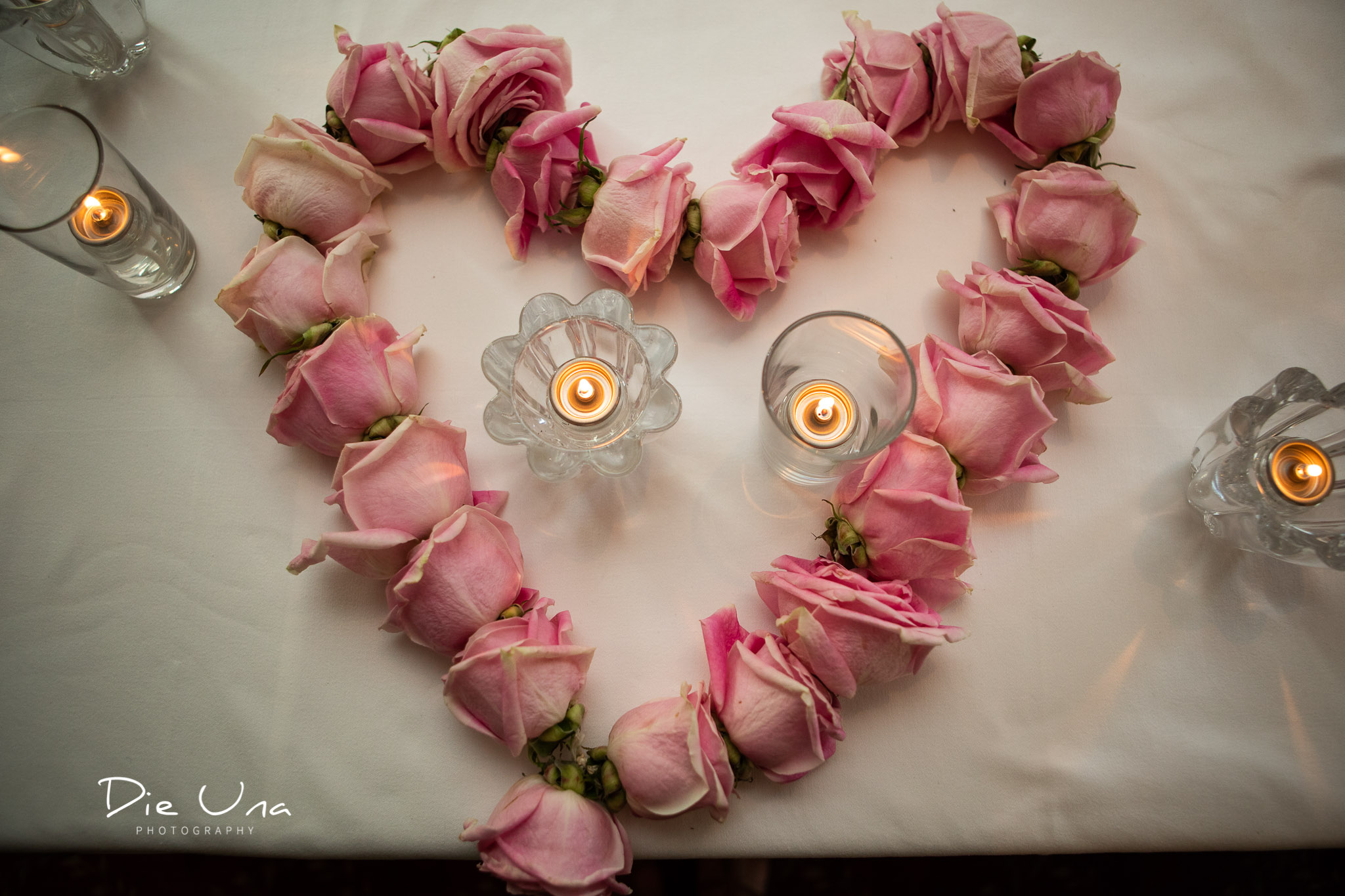 rose garland in the shape of a heart on the head table at wedding reception.jpg