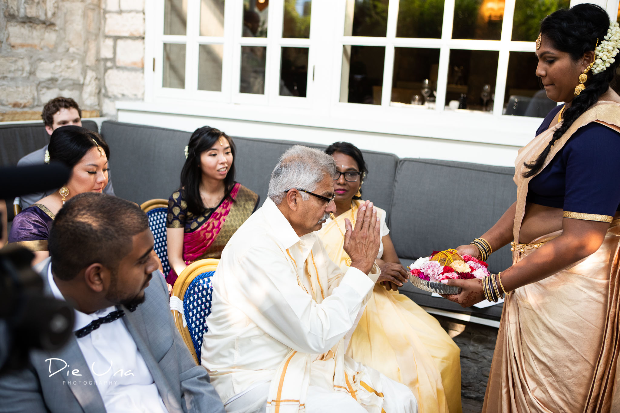 the thaali being blessed by father of the bride during Hindu wedding custom.jpg
