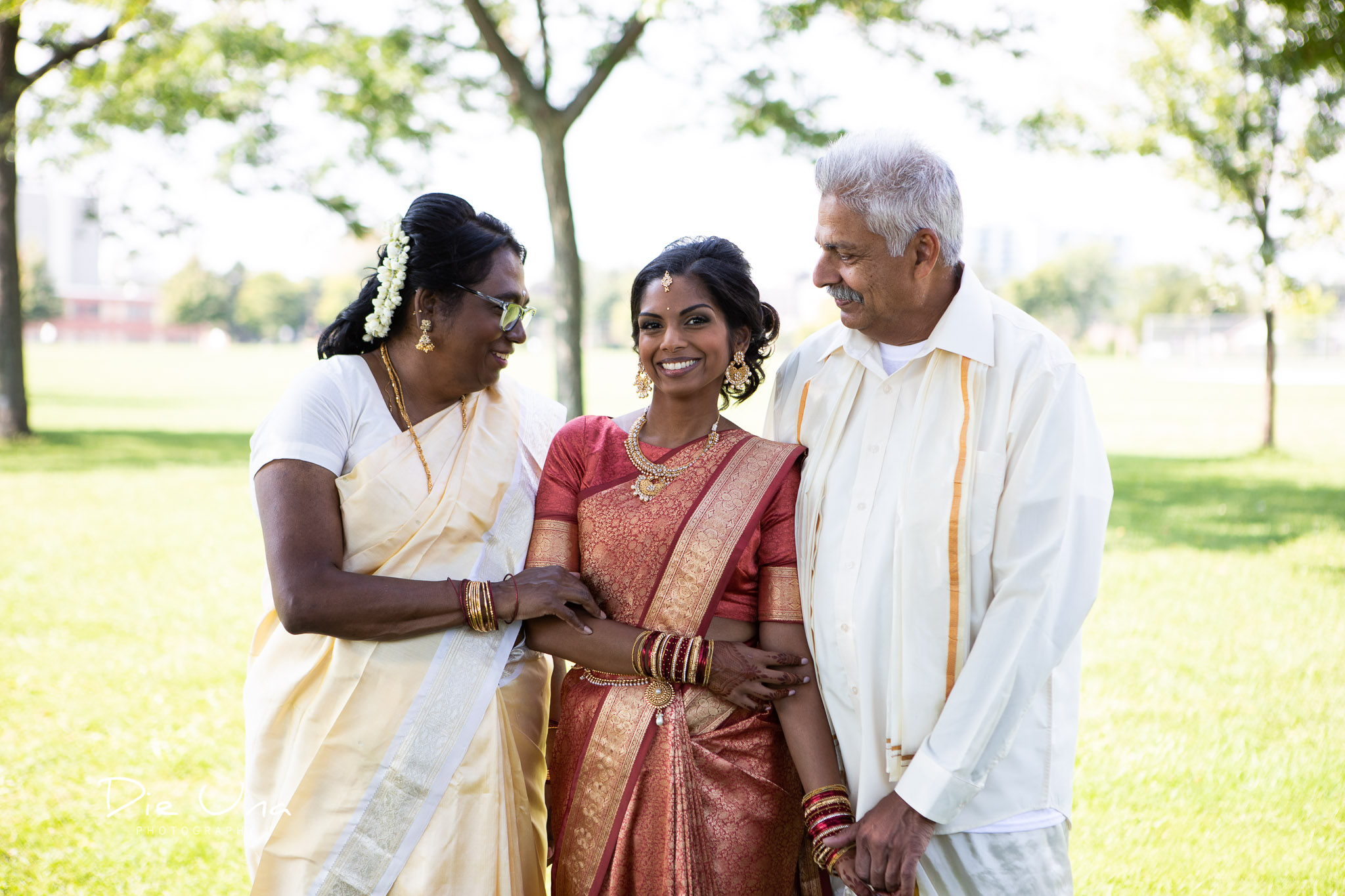 traditional Sri Lankan wedding portrait with bride and parents.jpg