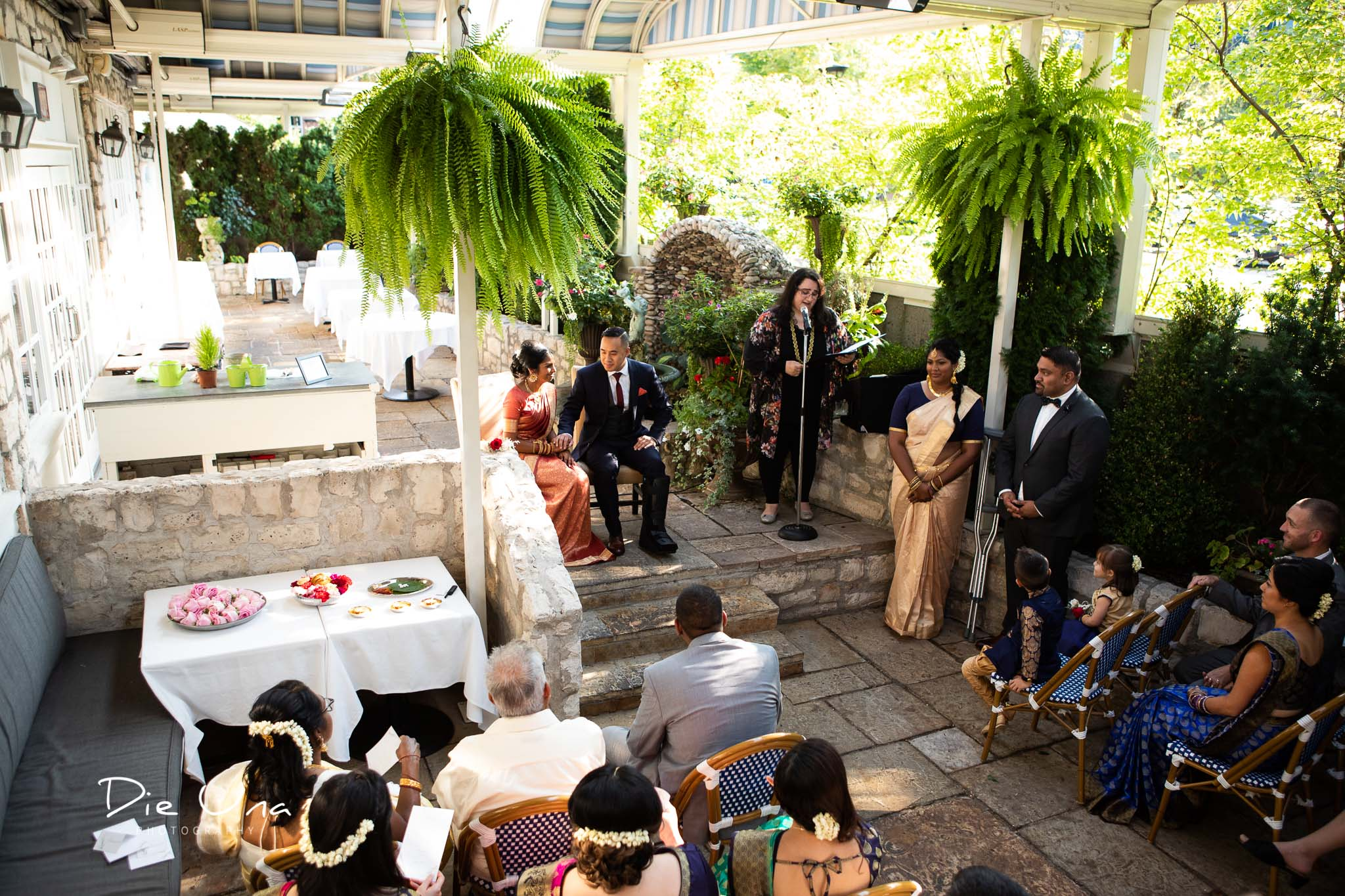 view of the terrace at Auberge du Pommier with all wedding guests.jpg