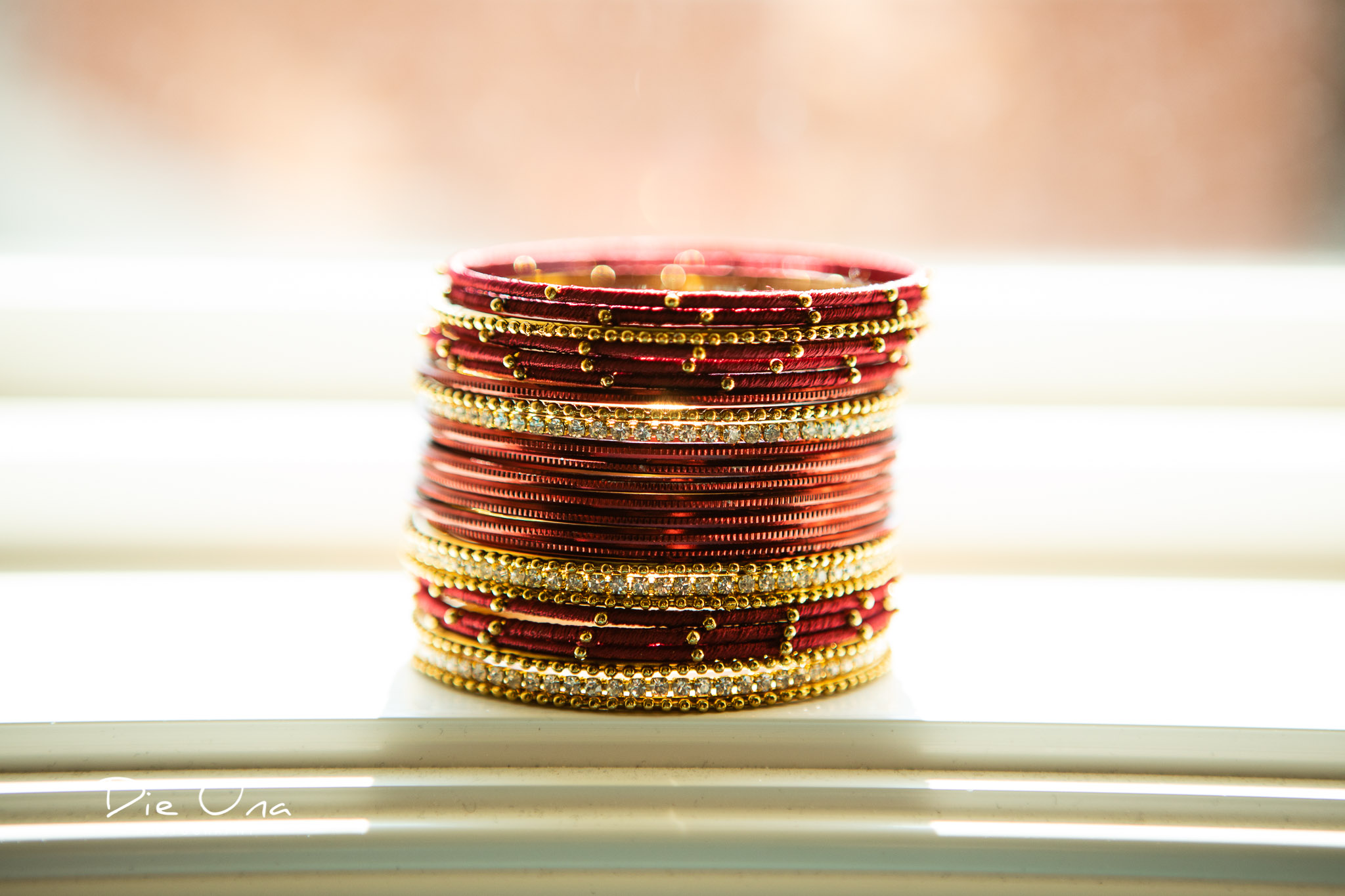 wedding bracelets stacked up in window.jpg