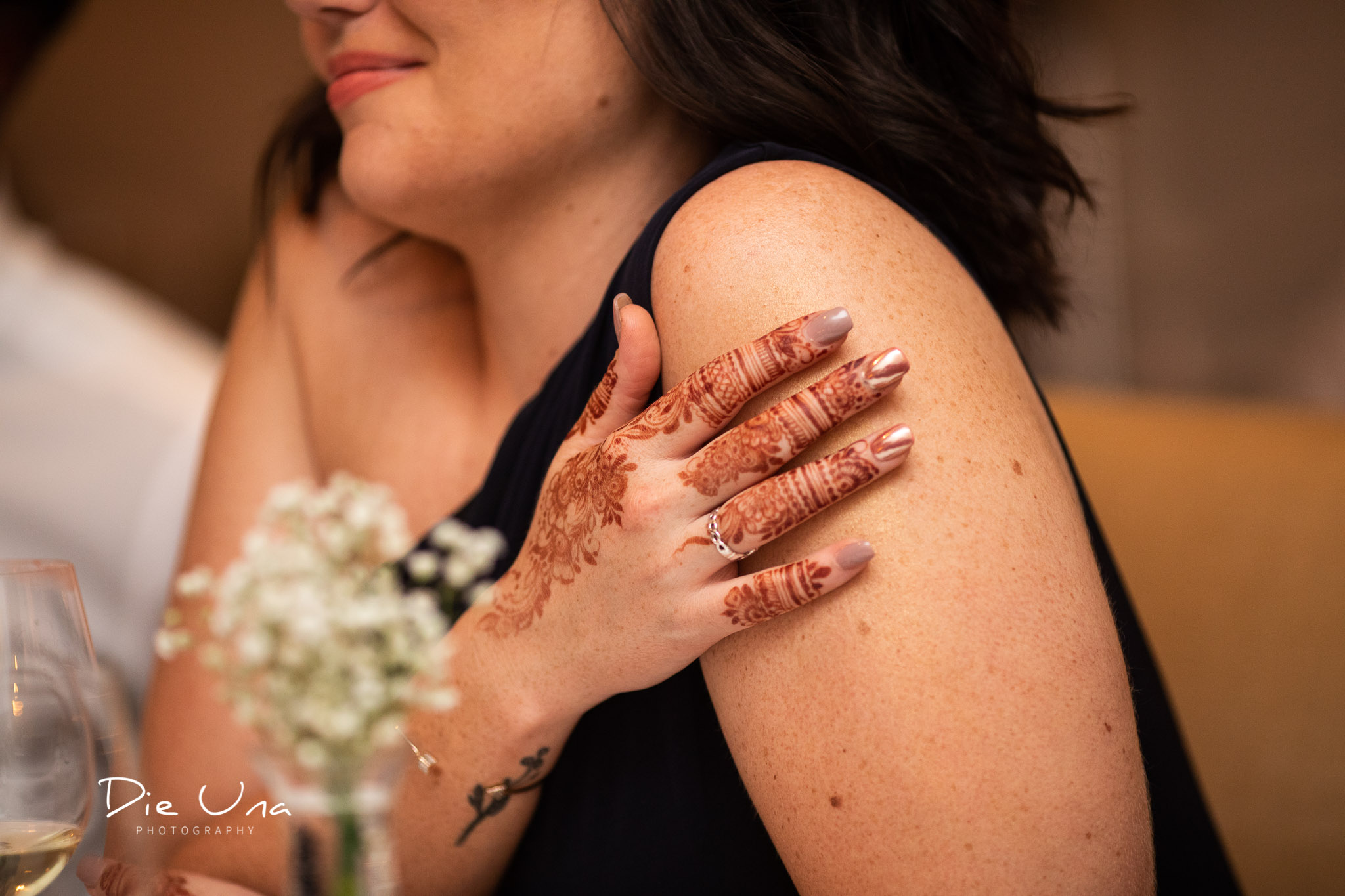 wedding guest moment captured with henna tattooed hand.jpg