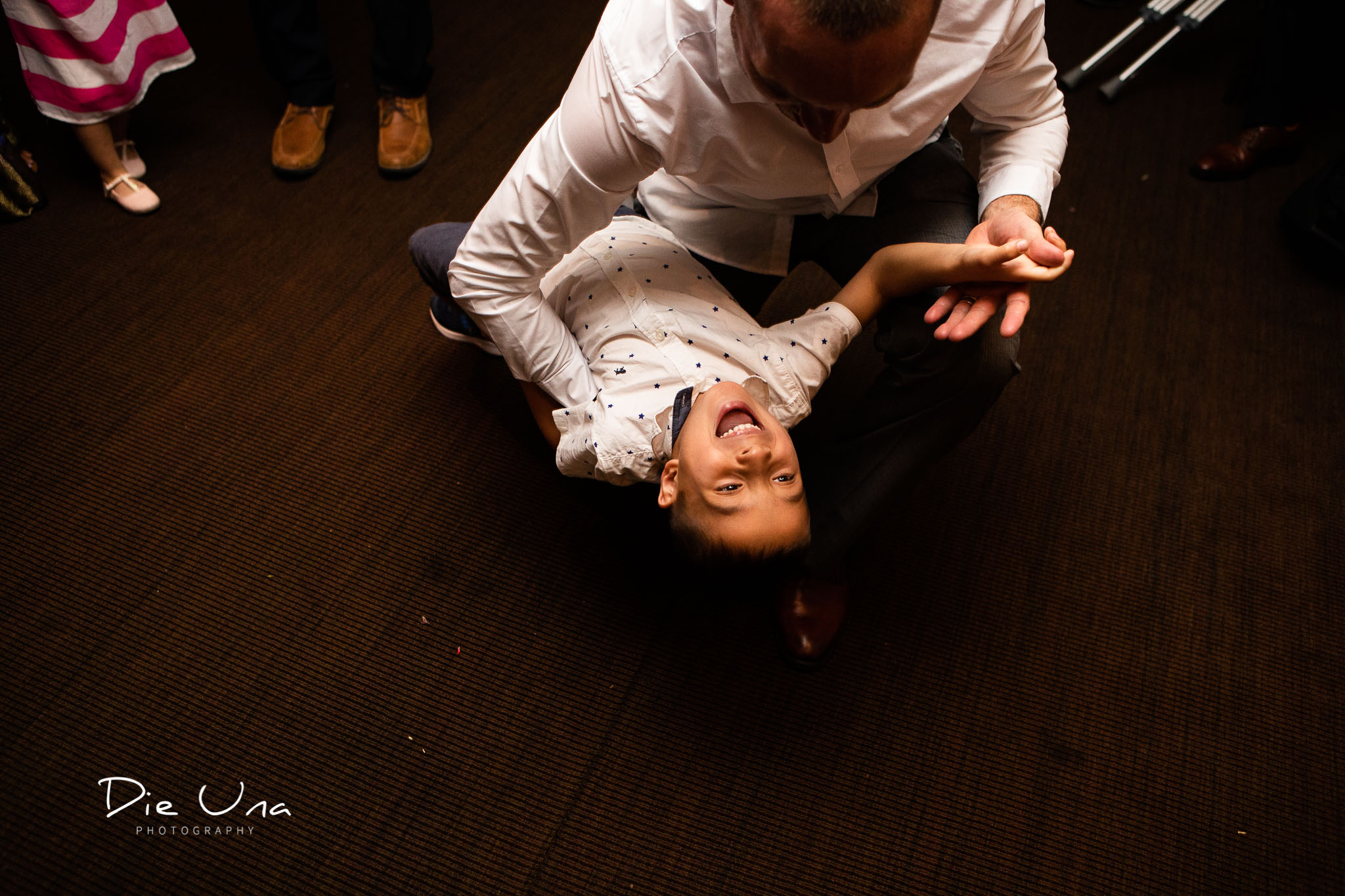 young child dancing with his dad during wedding reception.jpg