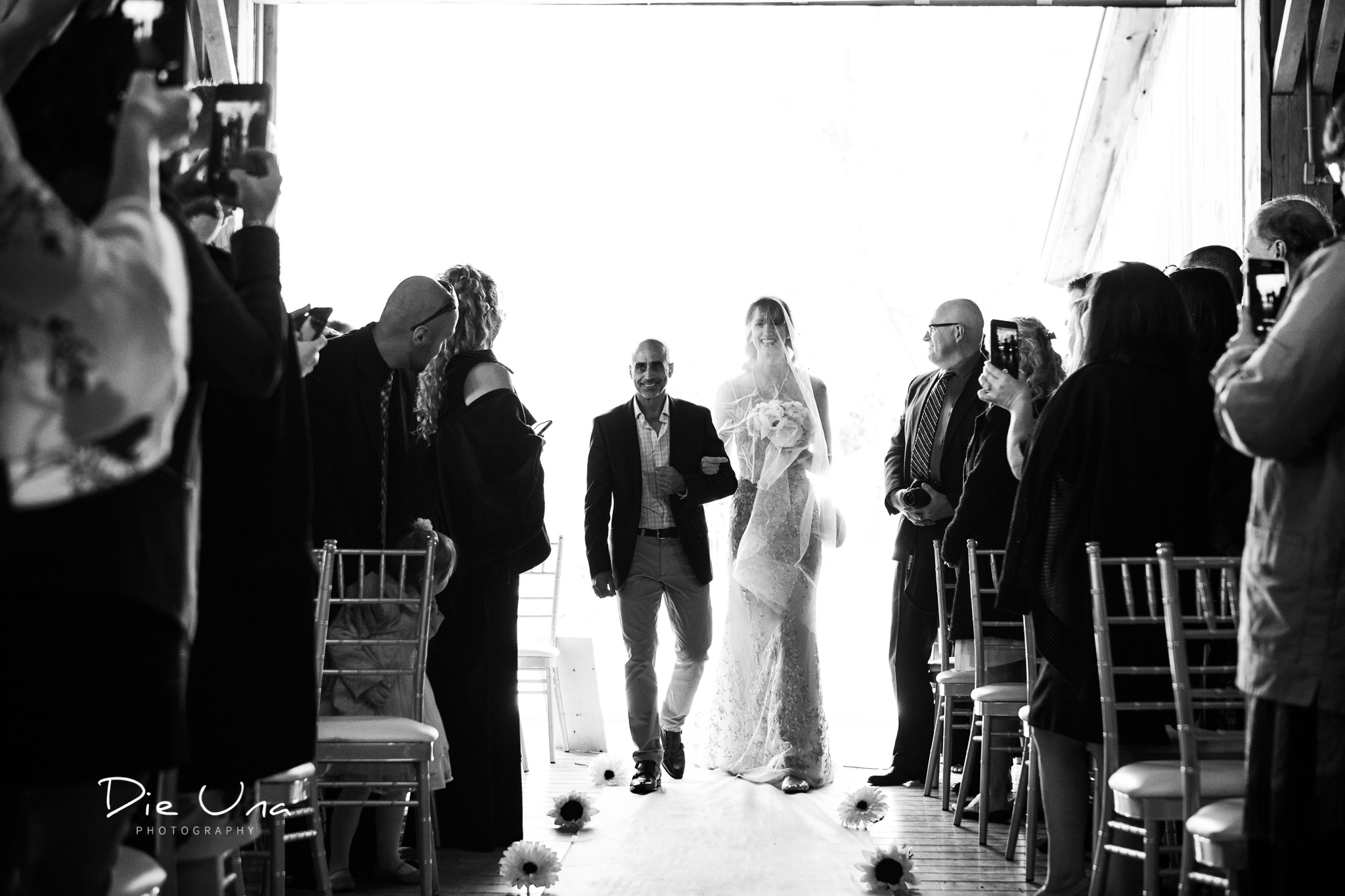 bride and father of the bride walking down the aisle during wedding ceremony black and whte wedding photography.jpg