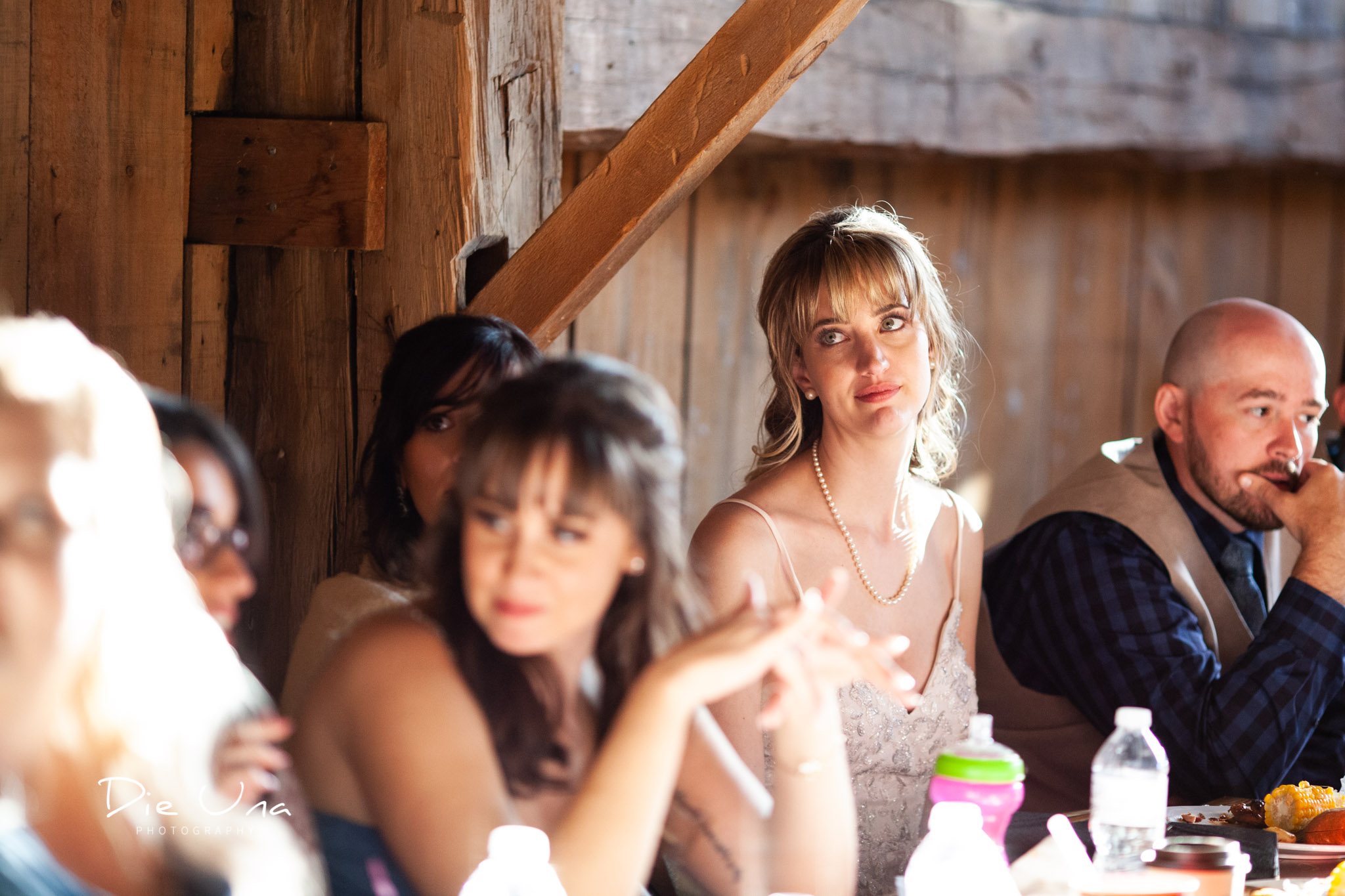 bride reacting to father during his wedding speech during barn wedding kitchener wedding photographer.jpg