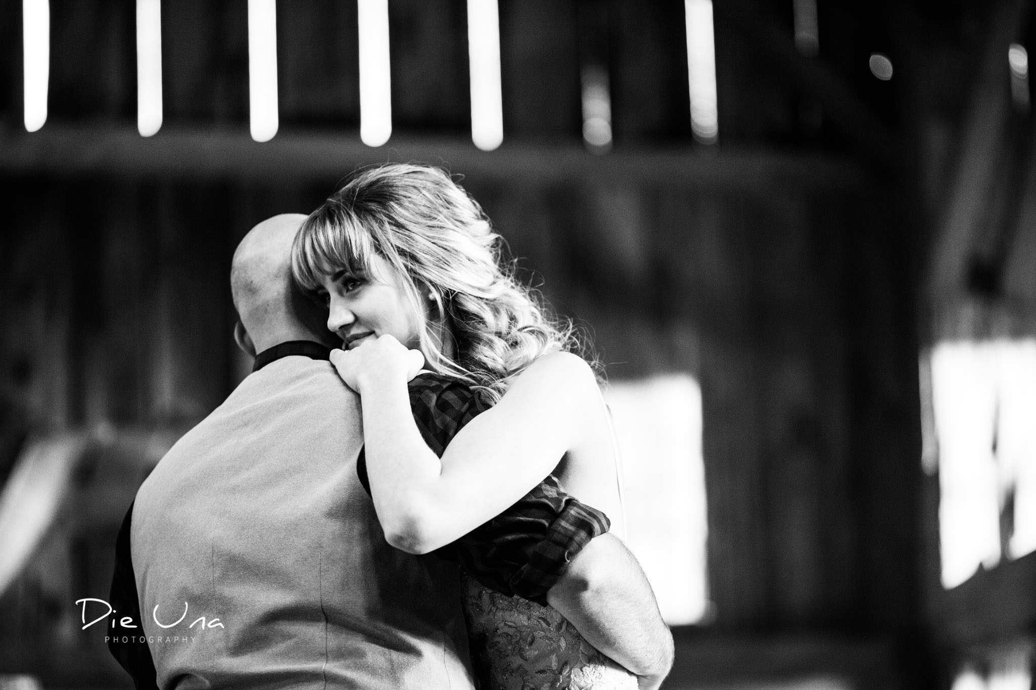 first dance with bride and groom in barn black and white kitchener photography.jpg