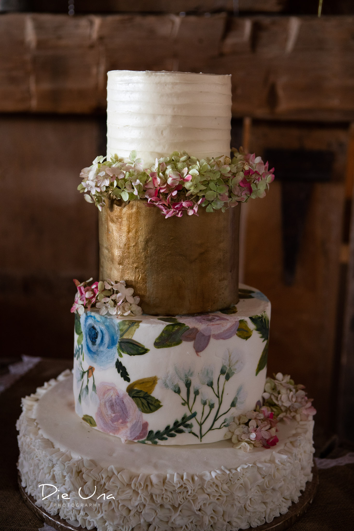 four tier wedding cake made by Jessica Harrison.jpg