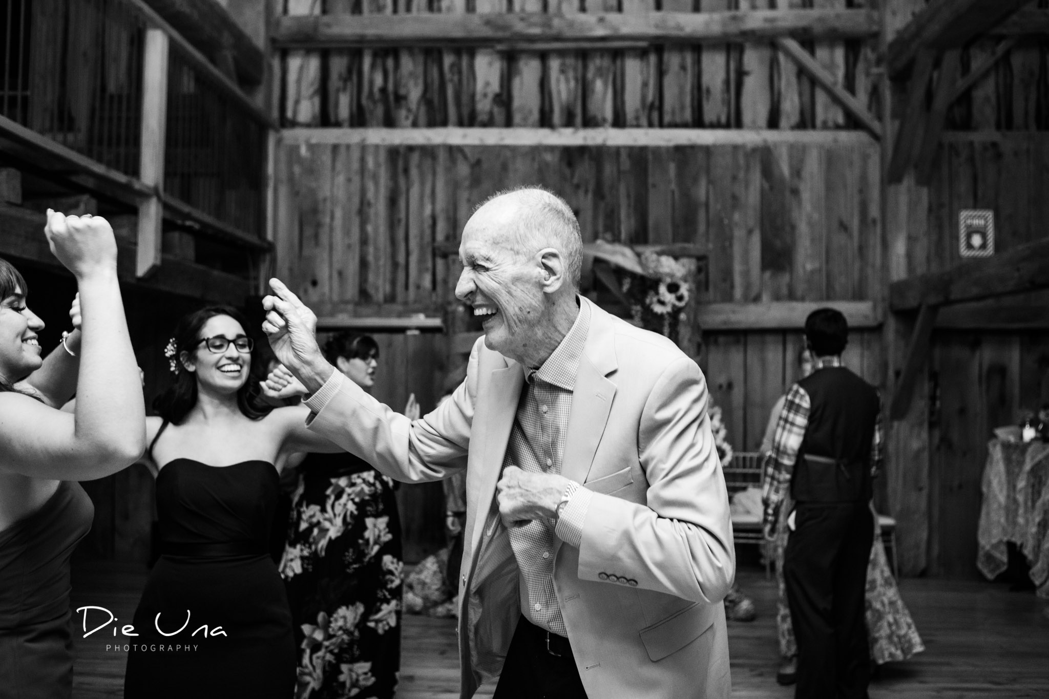 grandfather dancing during dance wedding reception in a barn.jpg