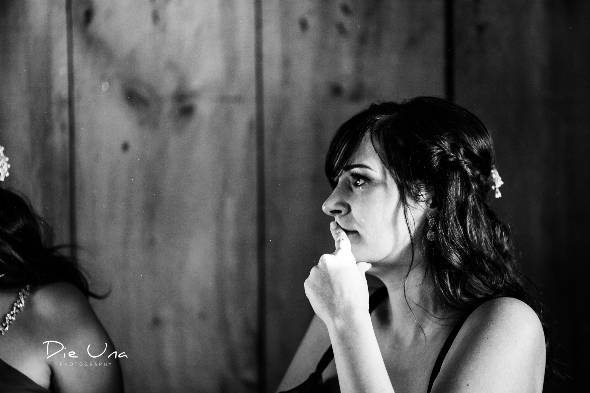 maid of honour with a tear running down her cheek during the brides wedding speech kitchener wedding photographer.jpg