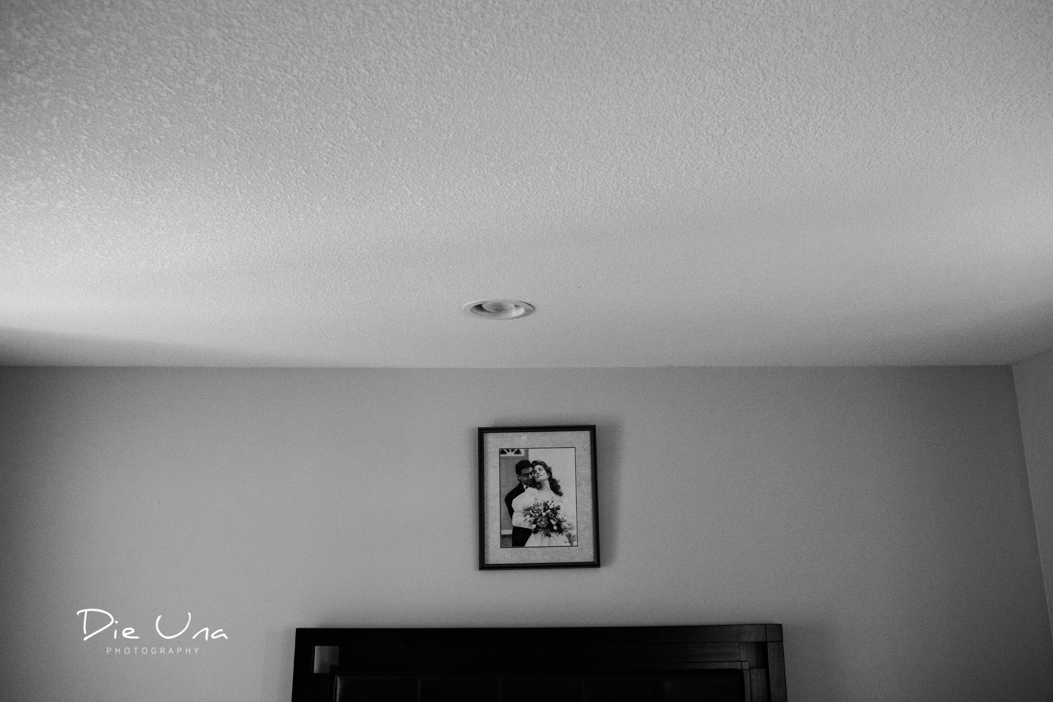 Old wedding portrait hanging in bride getting ready space black and white wedding photography.jpg