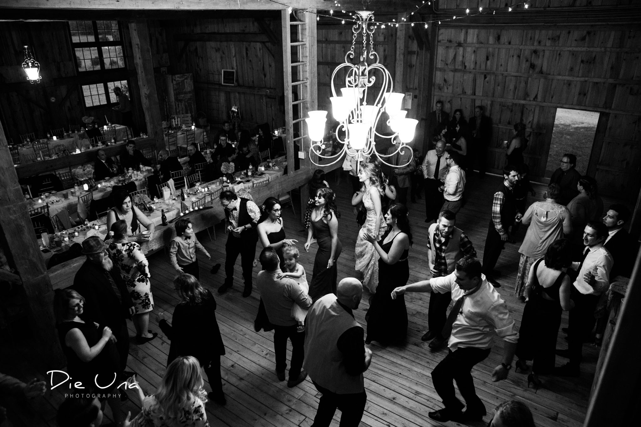 top view of wedding reception guests dancing black and white wedding photography.jpg