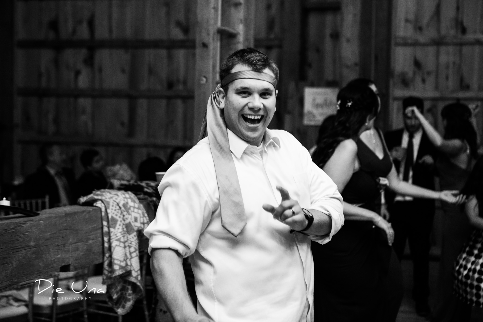 wedding guest wearing tie around his head black and white wedding photography.jpg