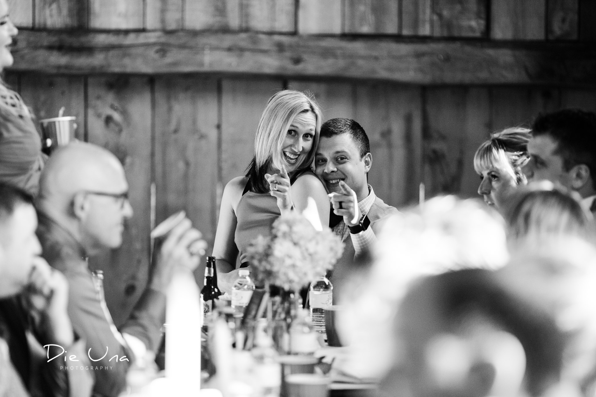 wedding guests being silly during wedding reception black and white candid photography.jpg