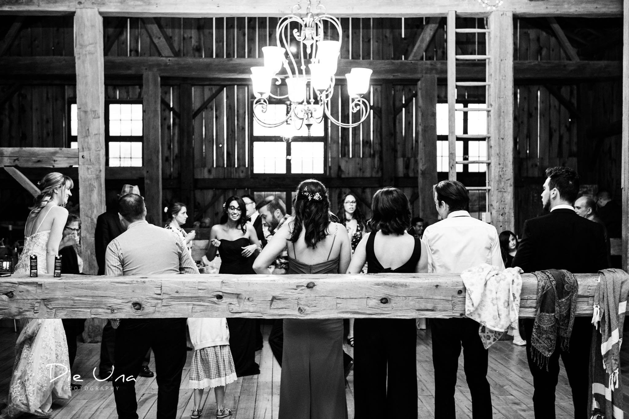 wedding guests standing back and watching the dancing black and white wedding photography.jpg
