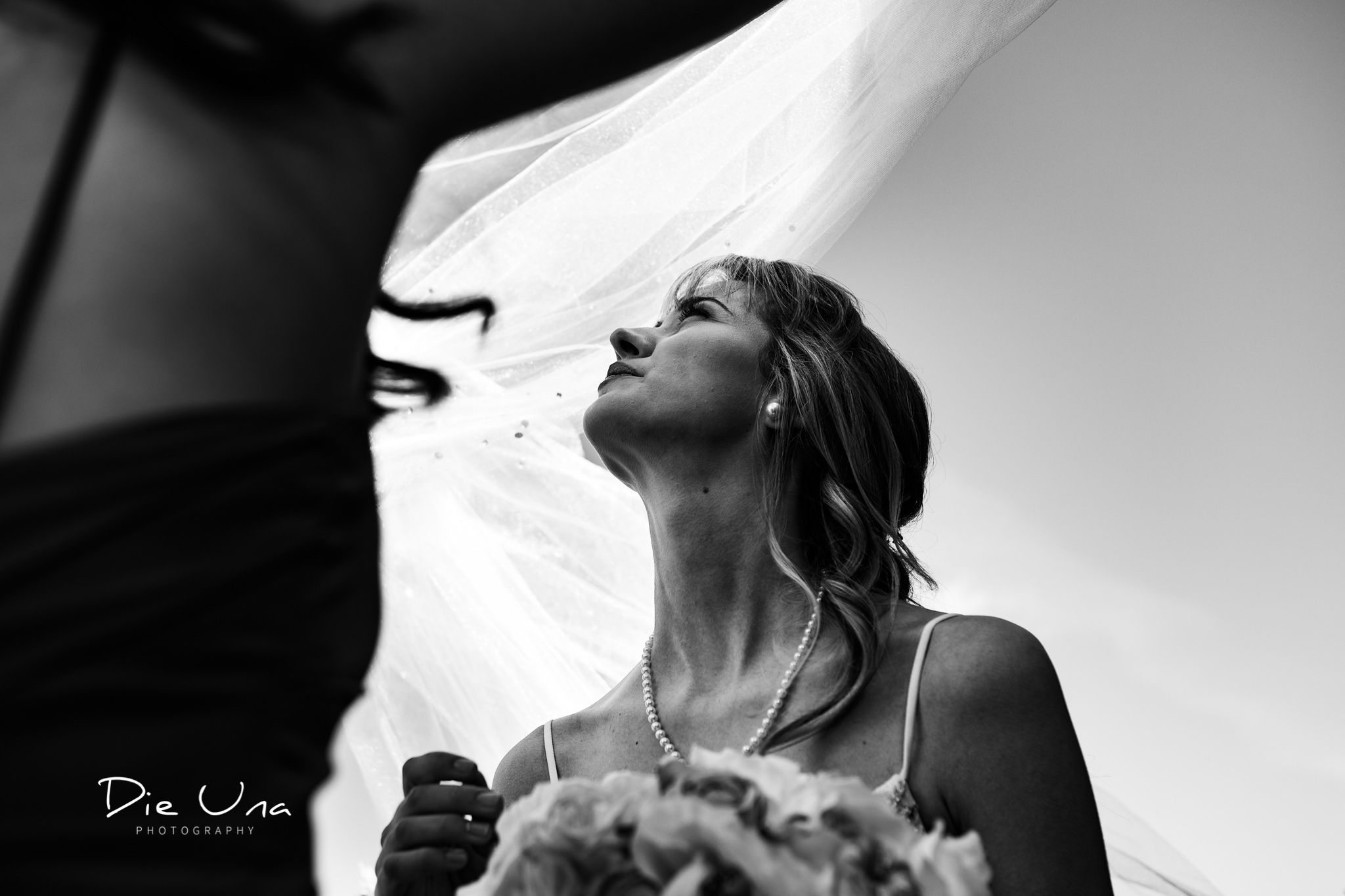wedding veil getting blown away by wind black and white wedding photography.jpg