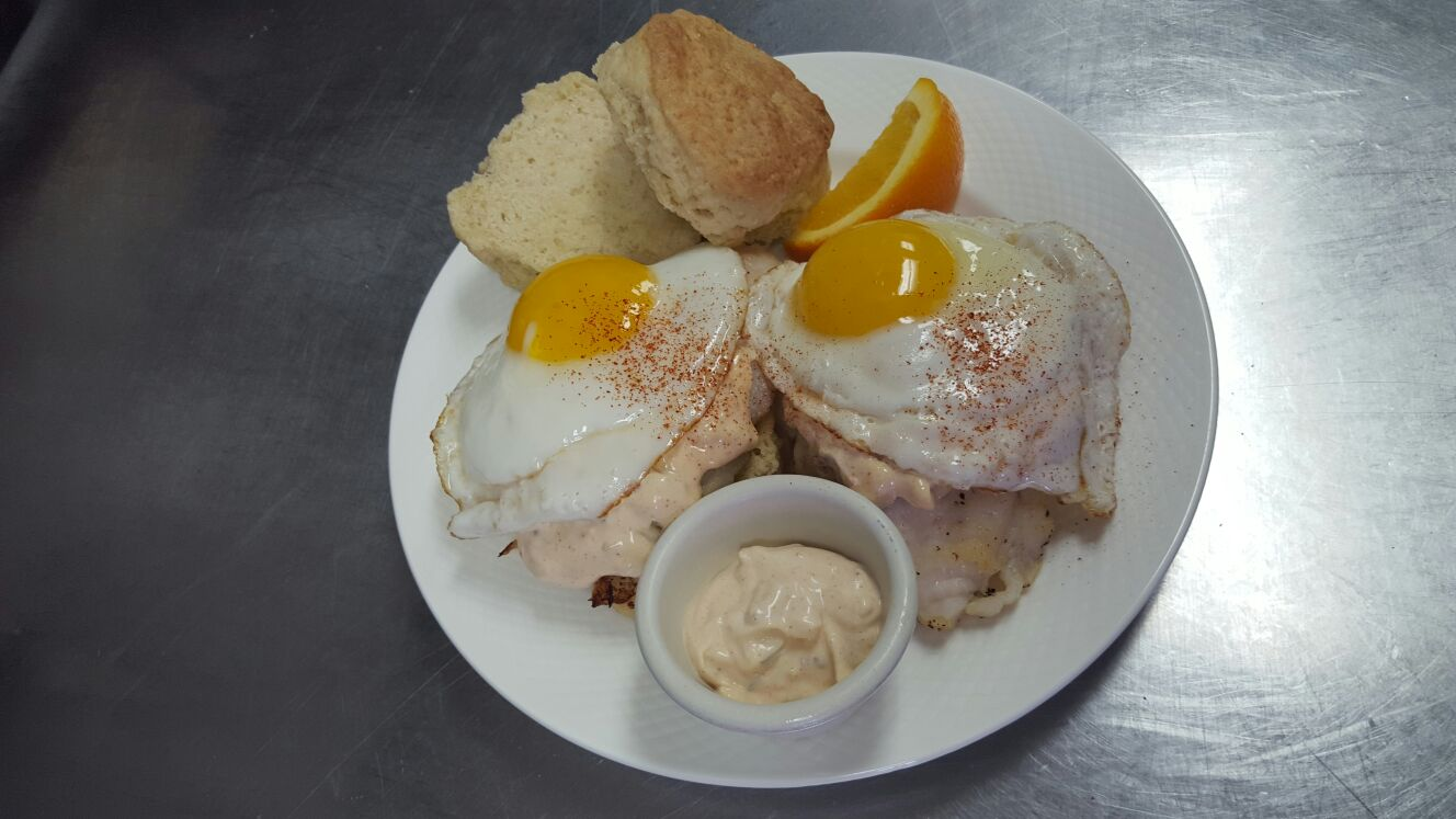 Homemade biscuits served with pan fried Basa fish topped with tartar sauce and 2 eggs cooked to order.