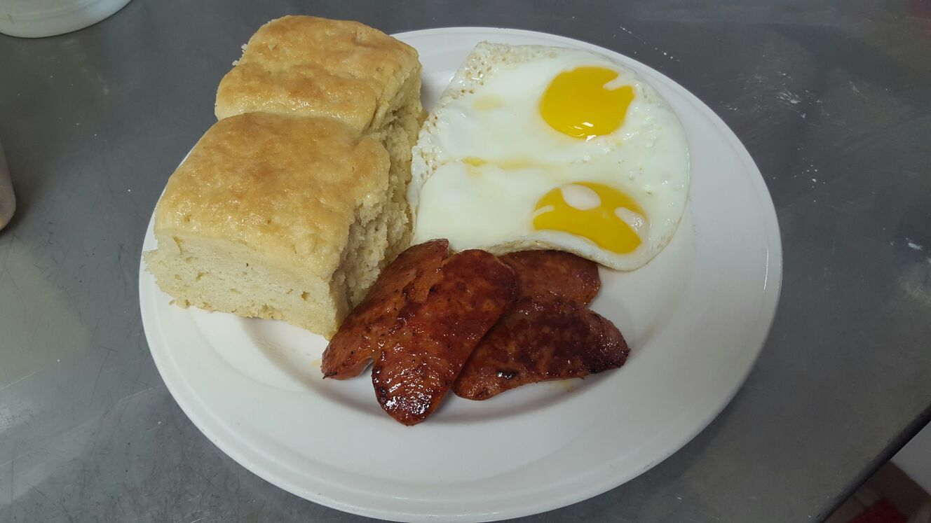 2 Homemade Biscuits served with 2 eggs cooked to order and a choice of meat.