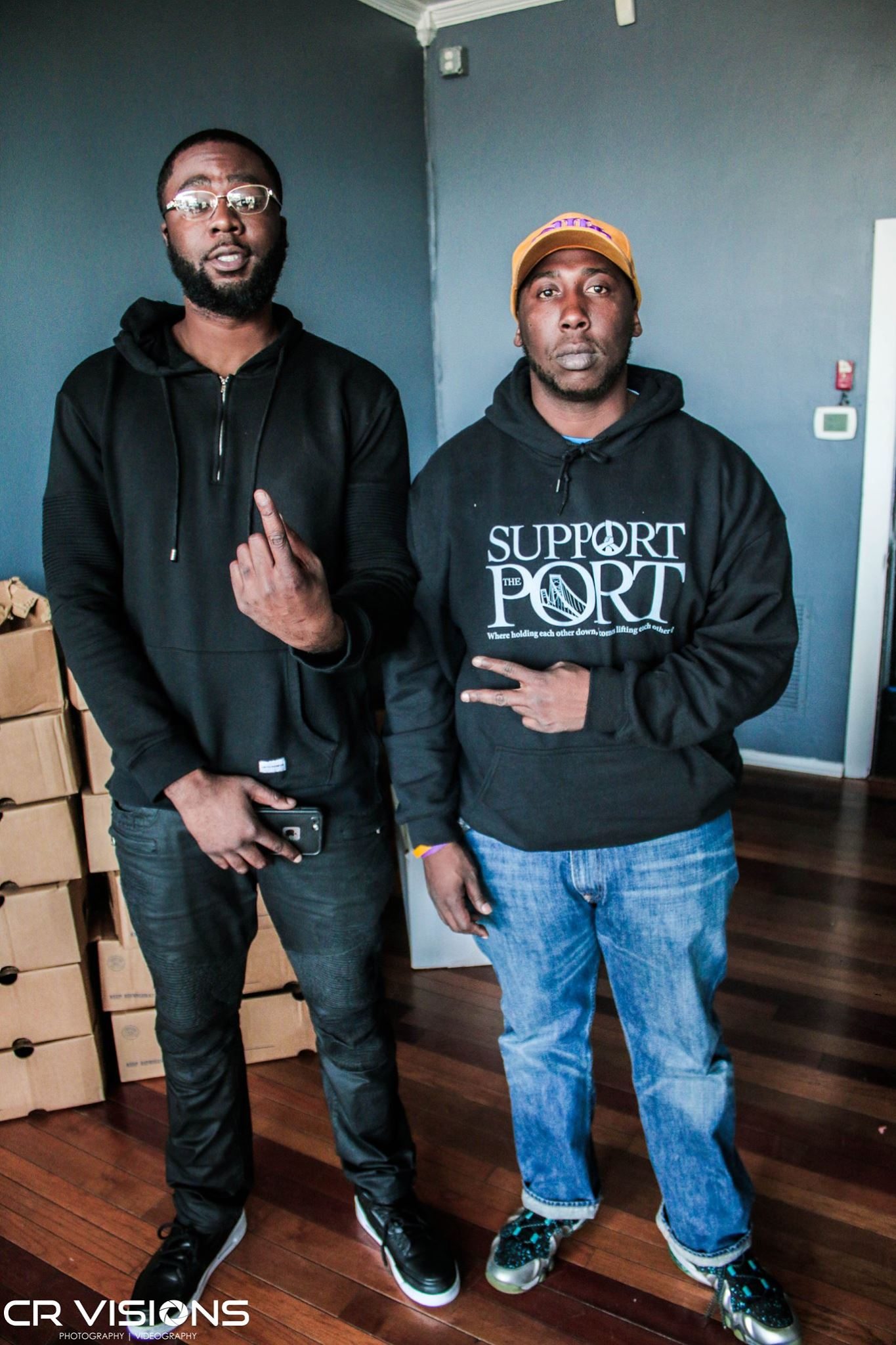 Devante BloodWorth Owner of On The Edge Barber & Cedric Harrison Exec Director of Support The Port Foundation, Inc. Posing for The Camera during Turkey Bowl Tuesday (Free Turkey Giveaway)