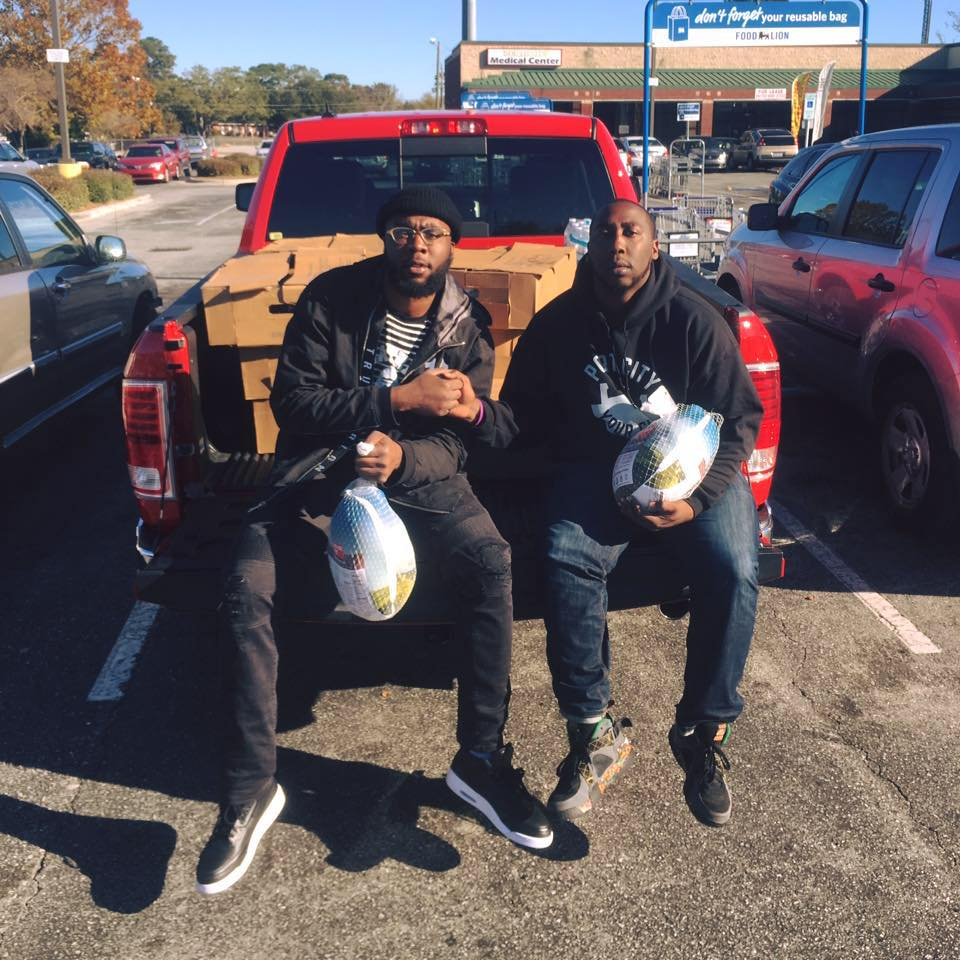 Devante BloodWorth Owner of On The Edge Barber & Cedric Harrison Exec Director of Support The Port Foundation, Inc. Posing for The Camera After Purchasing 100 Turkeys for Turkey Bowl Tuesday (Free Turkey Giveaway)