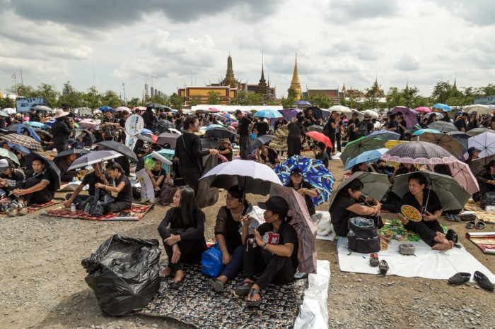 Crowd gathers in Sanam Luang in Bangkok to sing the new anthem due to the loss of King Bhumibol Adulyadej