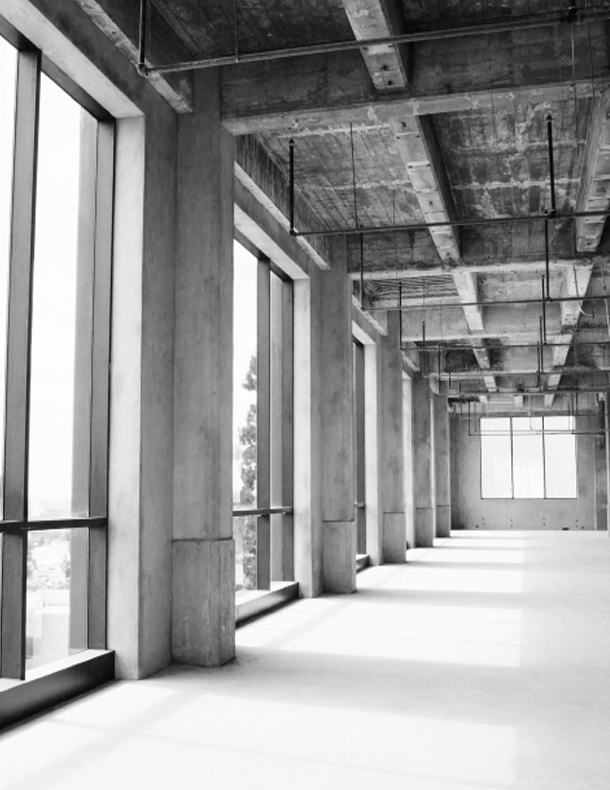Empty building interior with floor to ceiling windows