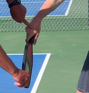 An eastern backhand grip puts the hand in a stronger position on top of/slightly behind the handle.