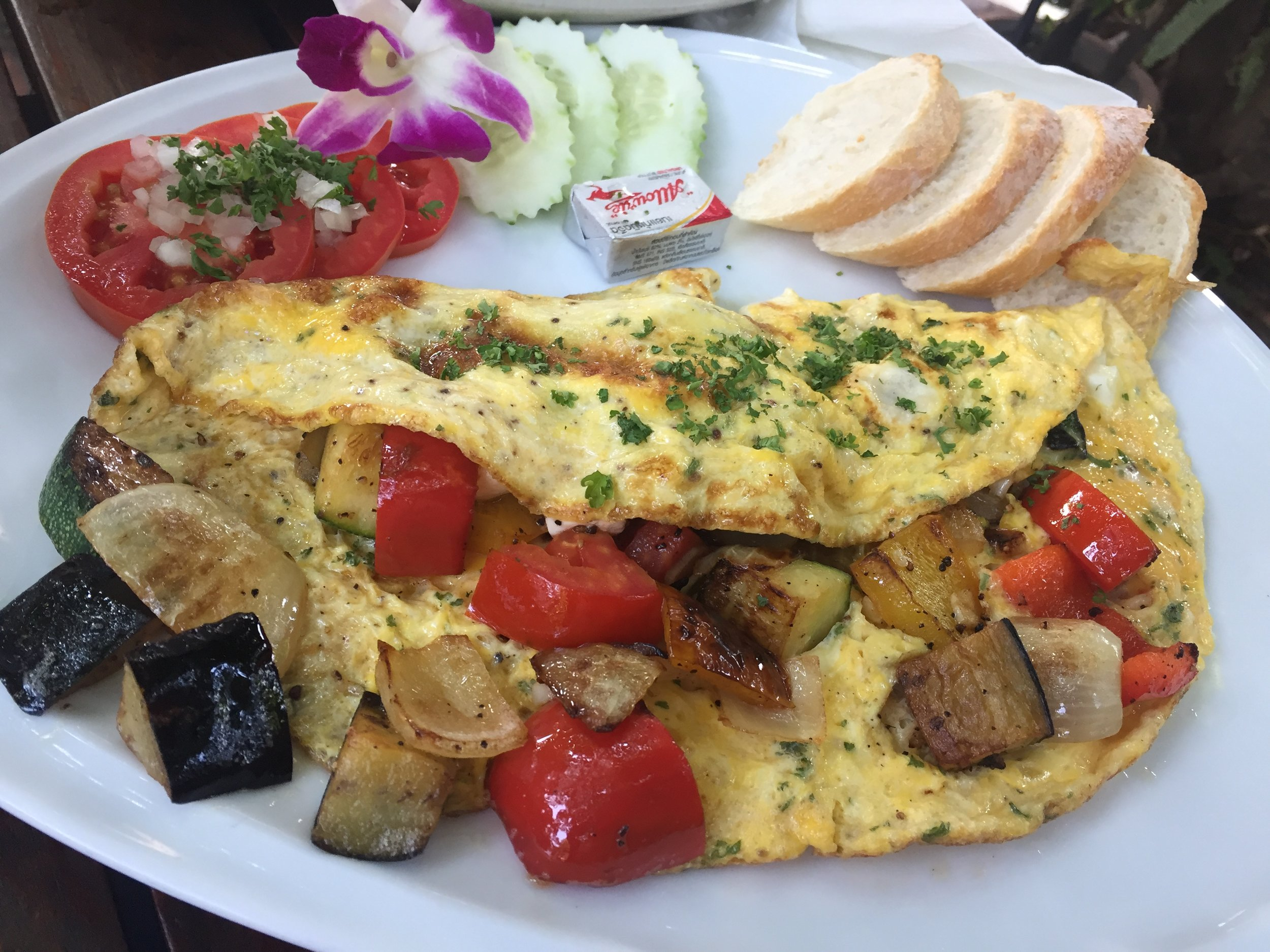 The largest veggie omelet I've ever laid eyes on. I'm sure they used at least six eggs... And I devoured every piece!