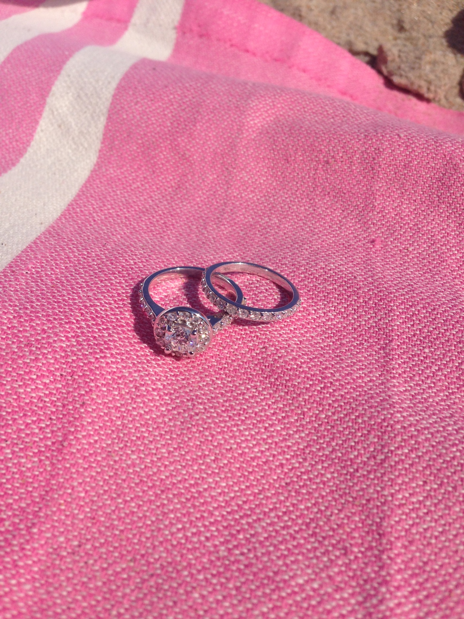 Original round center engagement ring reset into new halo design