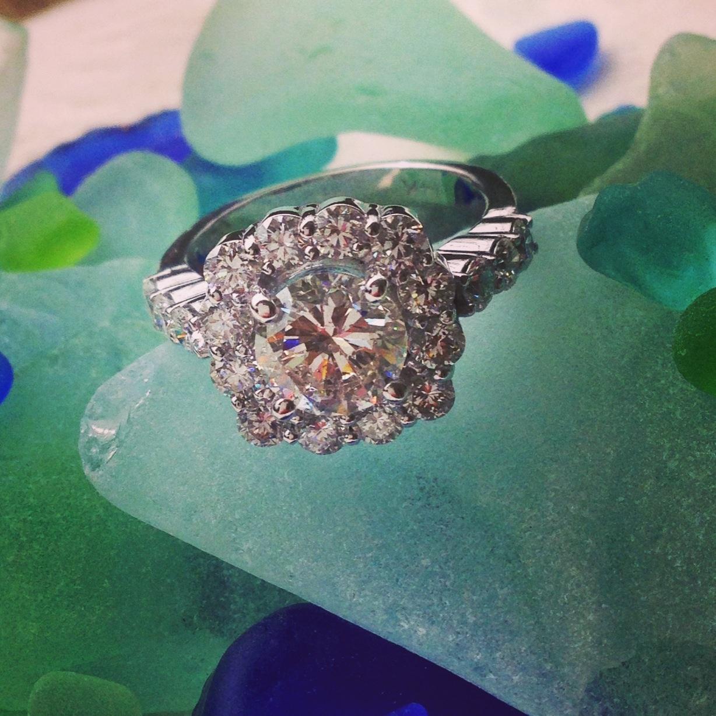 Original center round diamond reset into cushion cut shape design