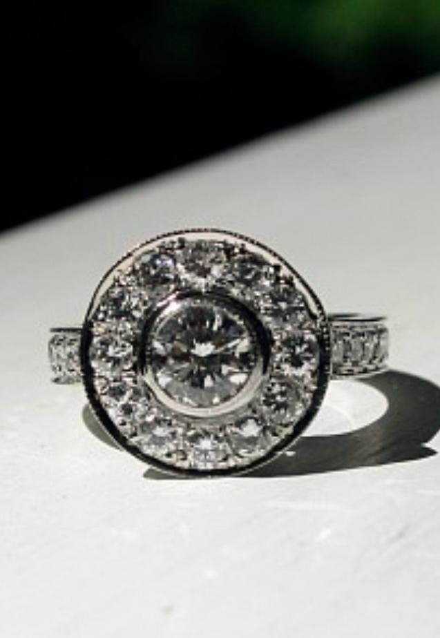 Original engagement ring center reset into halo design