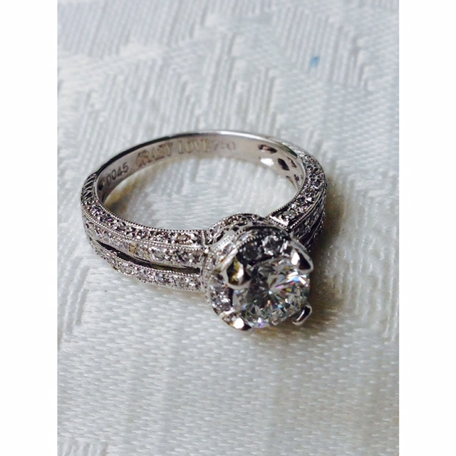 GIA Certified Diamond Provided and set into this beautiful 18k white gold mounting.