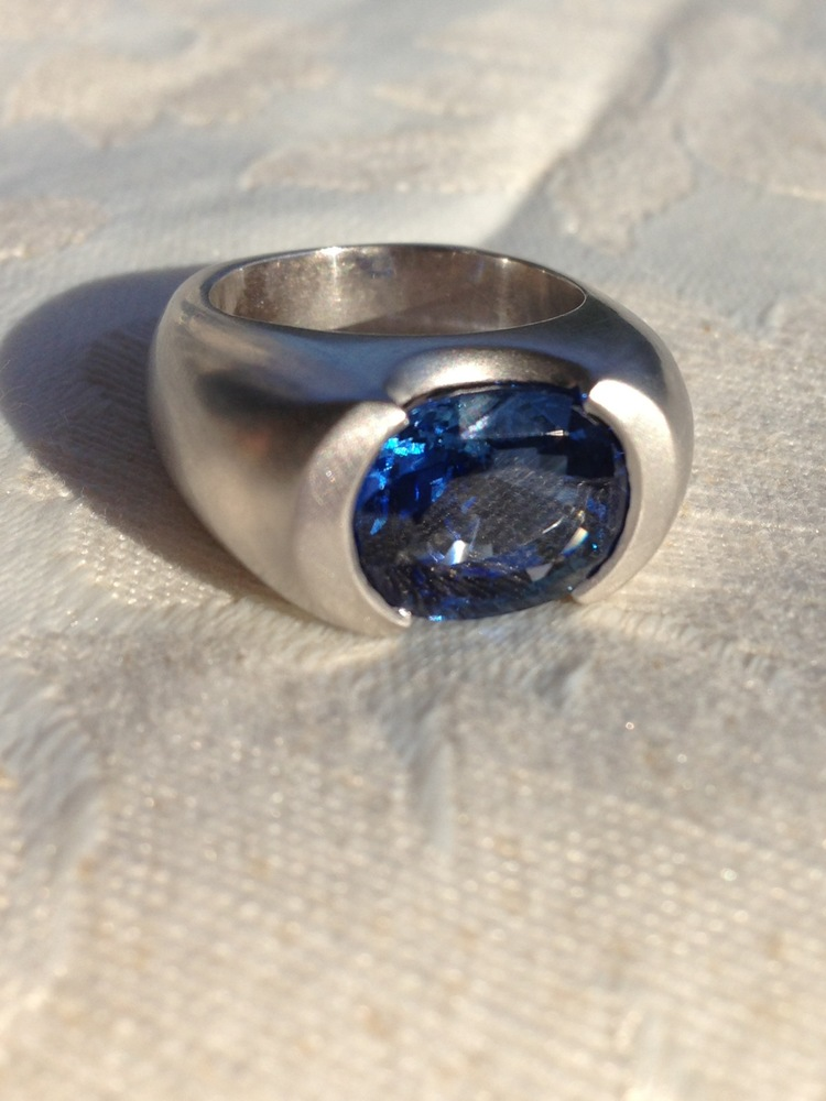 Provided this 8 carat Oval Sapphire and designed platinum setting.