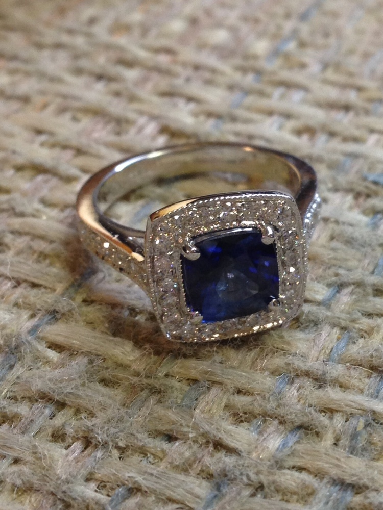 Provided this cushion cut sapphire and designed and set diamonds on mounting.