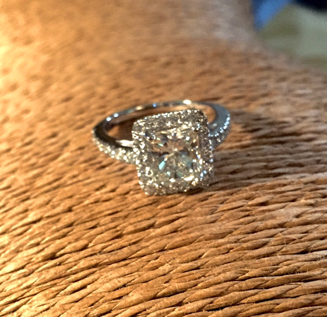 Provided Oval Shaped diamond and designed and set all stones in mounting to match center stone.