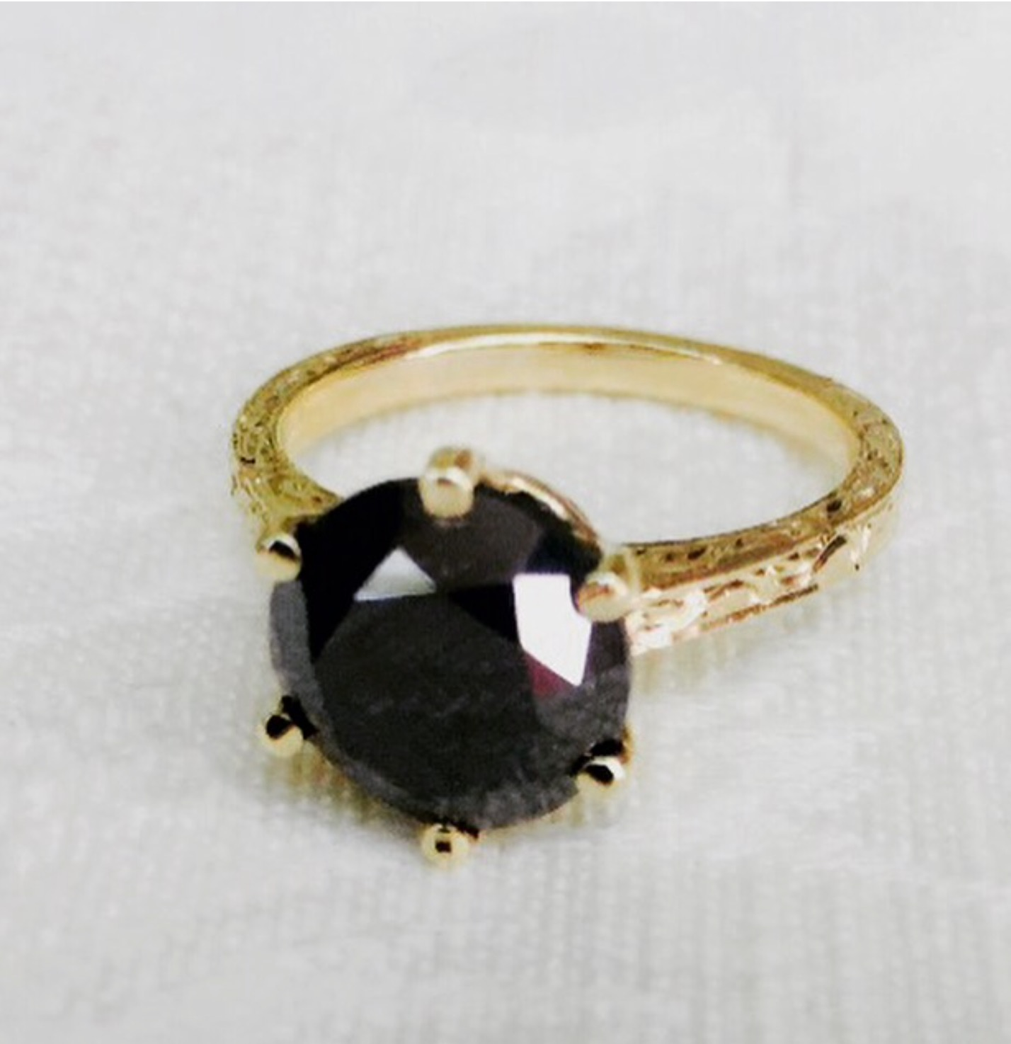 Custom made supplying this 2 carat black diamond and designed and made this 18k yellow gold mounting.
