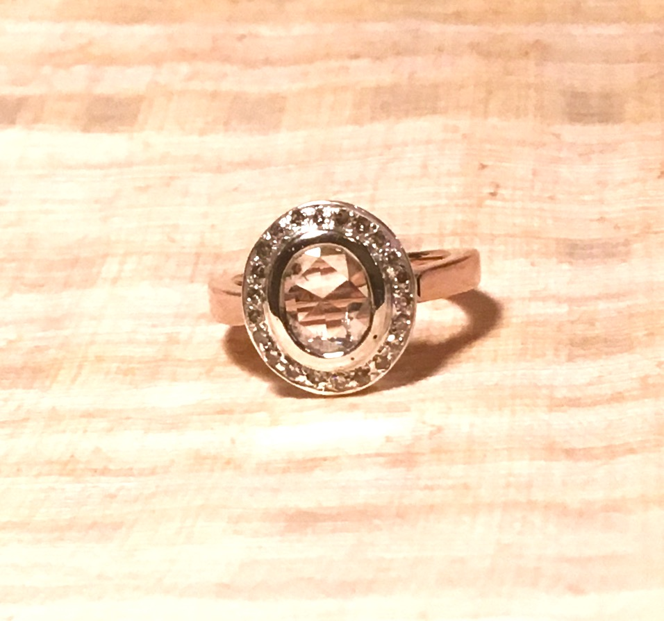 Custom made rose cut oval ring with champagne diamond halo and rose cut shank mounting.
